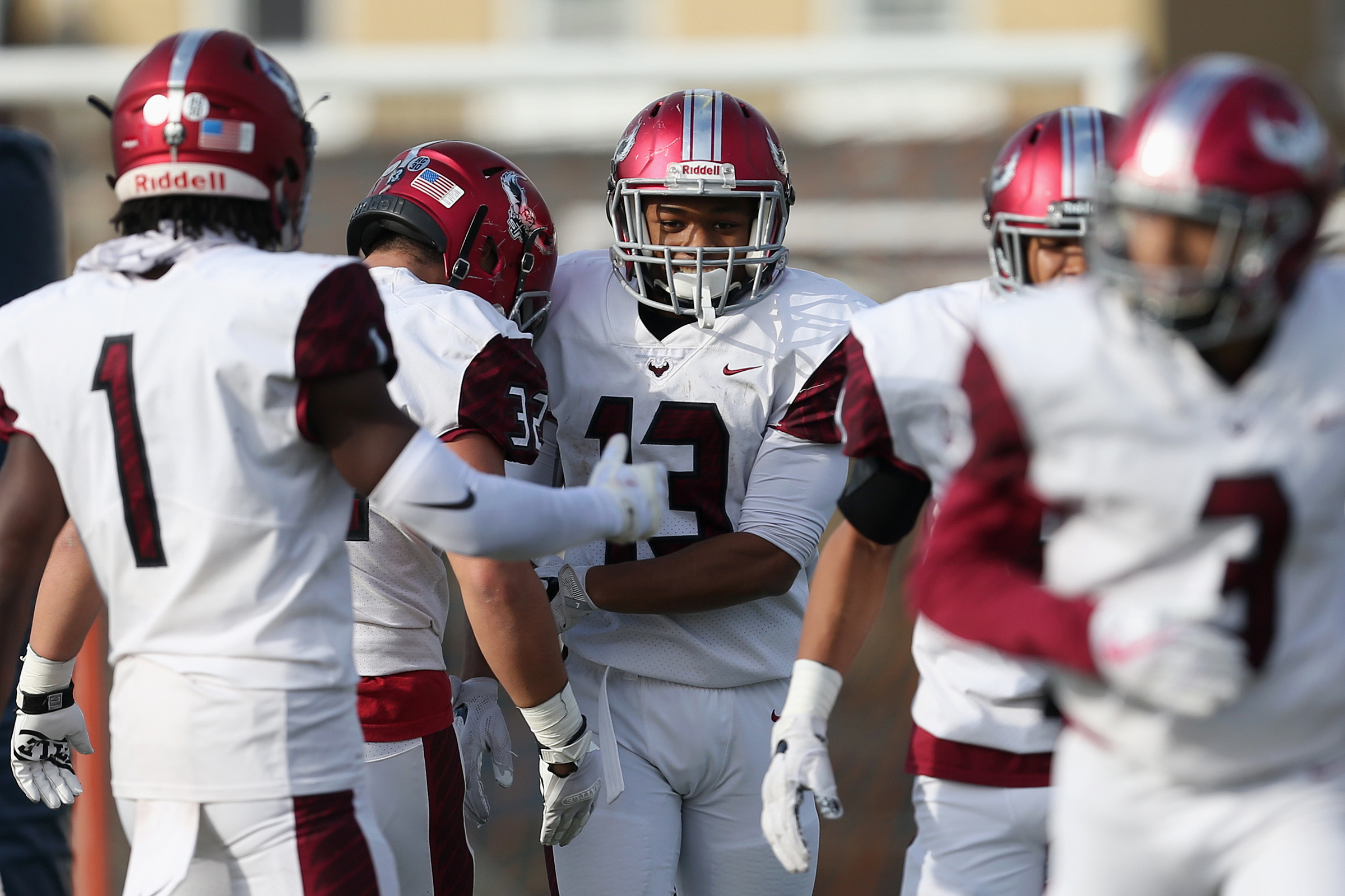 St. Joseph´s Prep´s Marques Mason (13) celebrates with teammates after scoring a touchdown in a PIAA Class 6A quarterfinal playoff against Parkland last season.