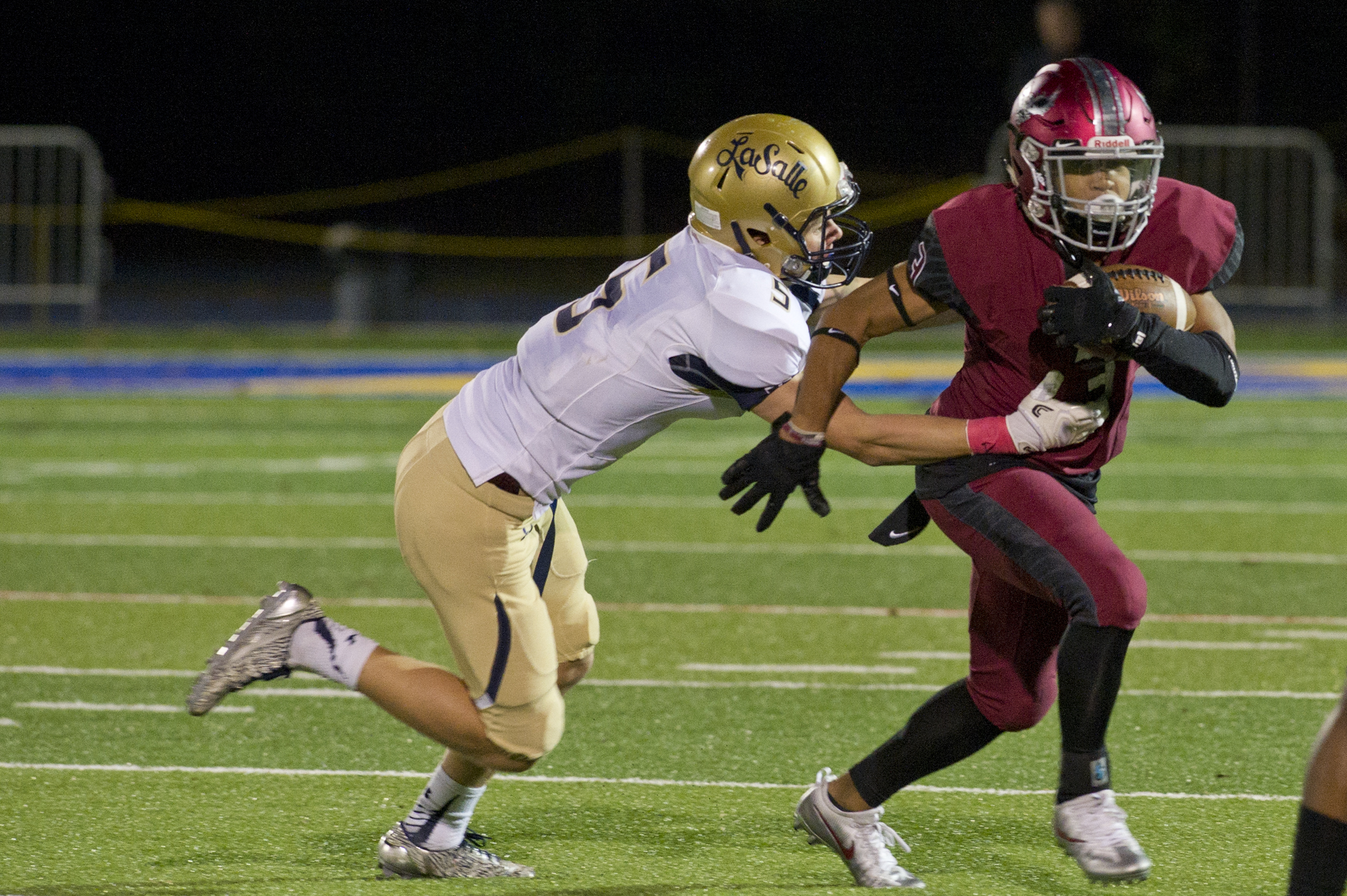 La Salle´s Sean Daly tries to take down St. Joseph´s Prep wide receiver James Cherry in a Catholic League game last season. ´s James Cherry during the first half of Friday night´s football game at Quick Stadium on the campus of Widener University in Chester, PA. Avi Steinhardt / For the Philadelphia Inquirer