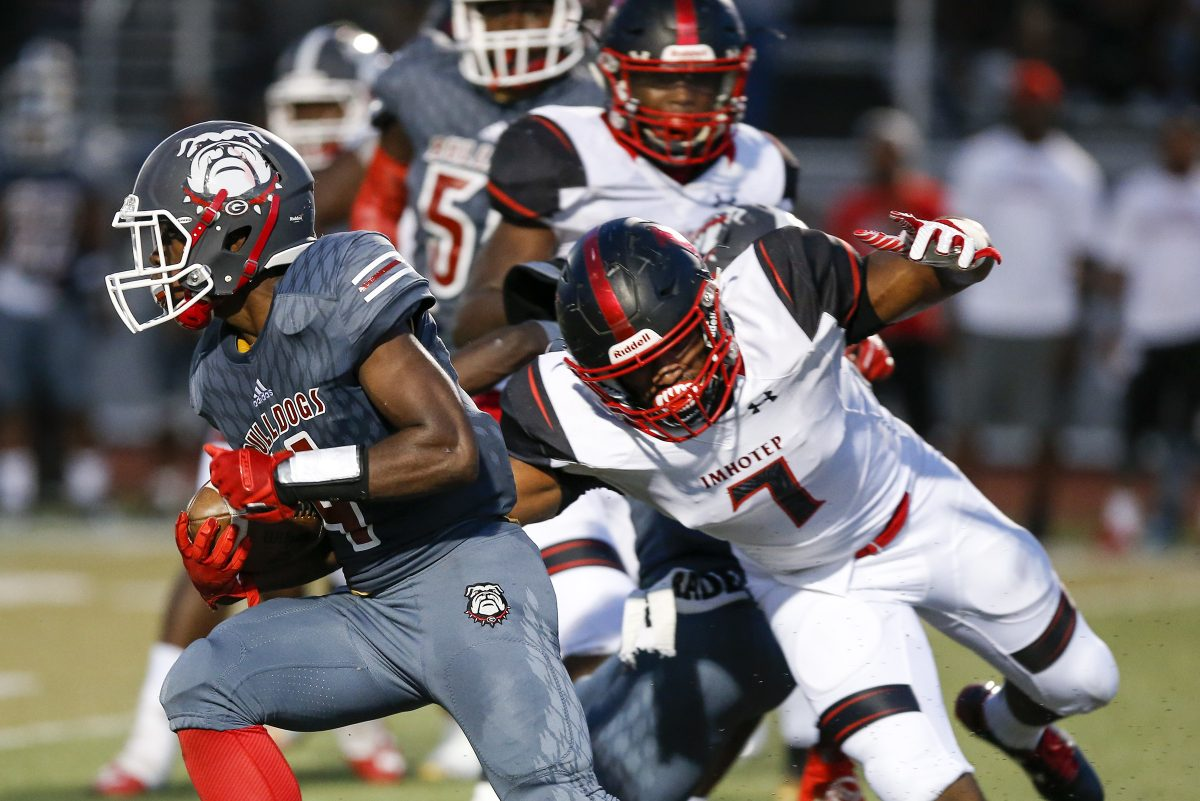 Omar Speights (right) tries to chase down a Simon Gratz ballcarrier in Imhotep Charter's 40-21 victory last season.