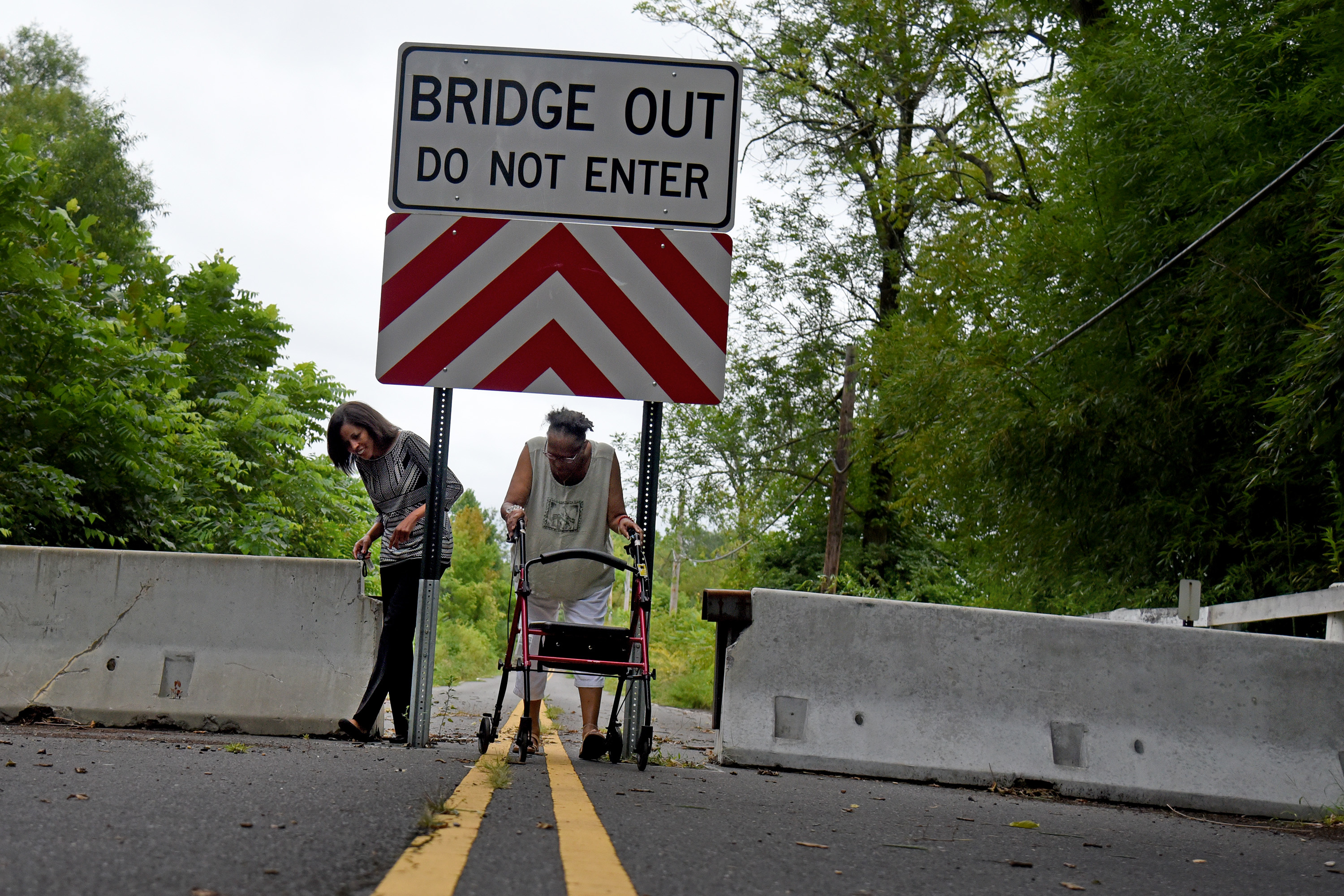 "Lori Howard (left) and Anne Hamilton (right) on the Centerton Bridge in August, three years after it was closed due to safety concerns. Howard started a ""Rebuild the Centerton Bridge"" campaign on Facebook."