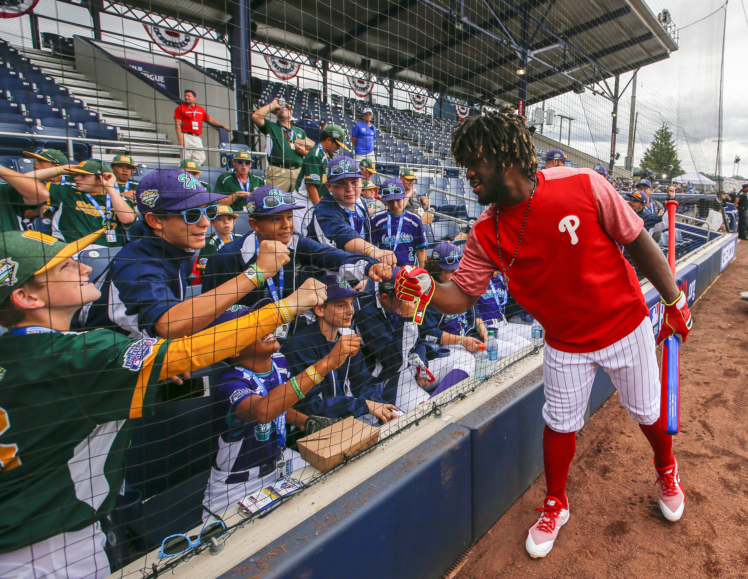 Odubel Herrera hands out some fist-bumps to Little Leaguers ahead of Sunday´s Mets-Phillies game at Historic Bowman Field in Williamsport.