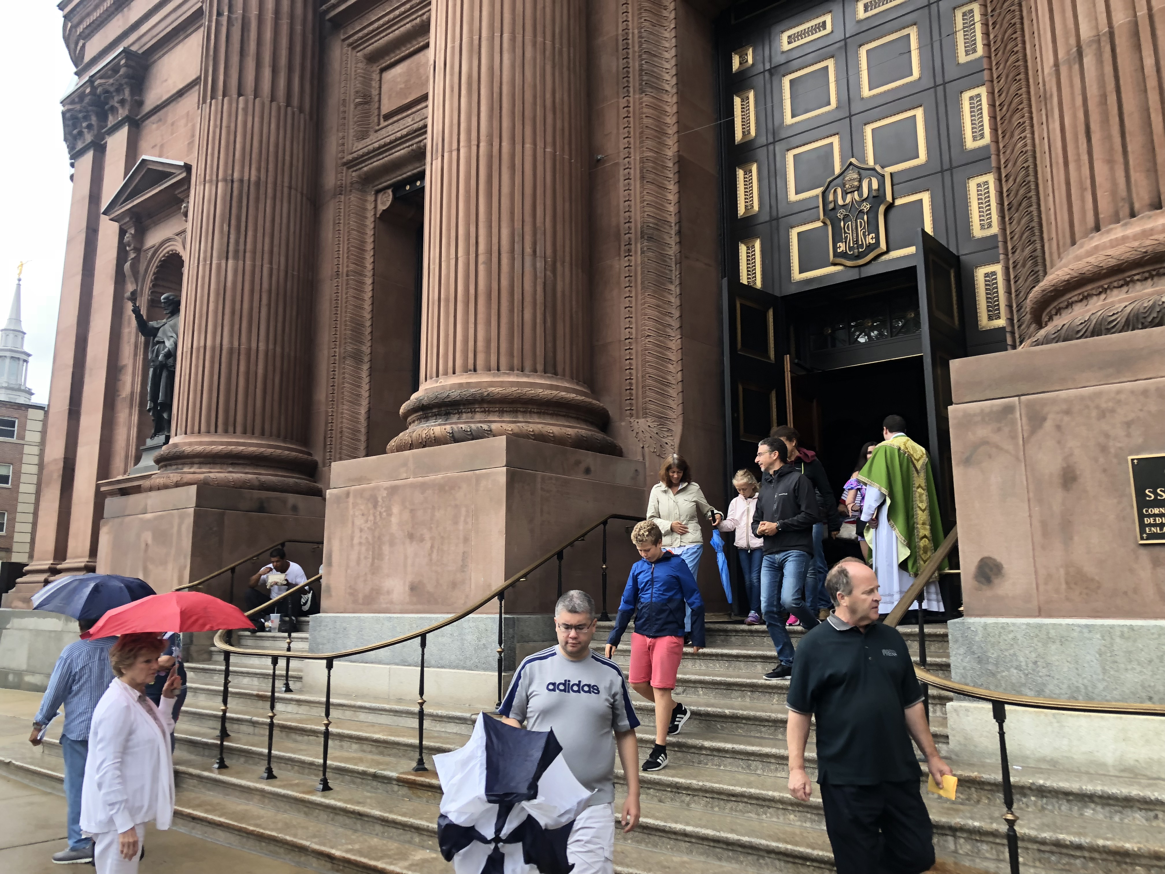 Churchgoers leave the Cathedral Basilica of Saints Peter and Paul after Sunday Mass.