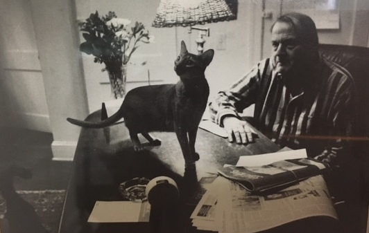 Dr. Morton Herskowitz in his office with cat Schatze.
