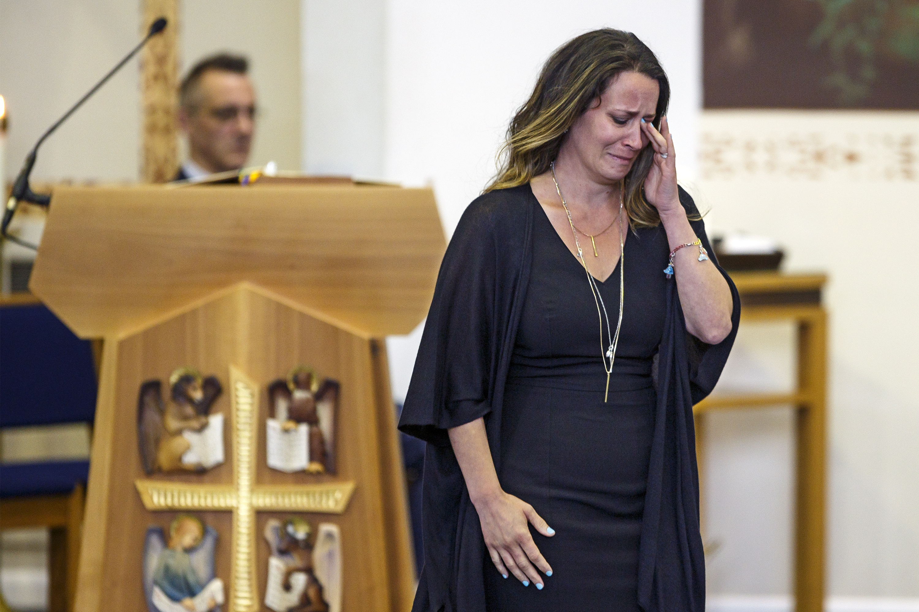 Kathryn Sherlock wipes away tears after speaking at the Aug. 11 funeral for her daughter, Kayden Mancuso.