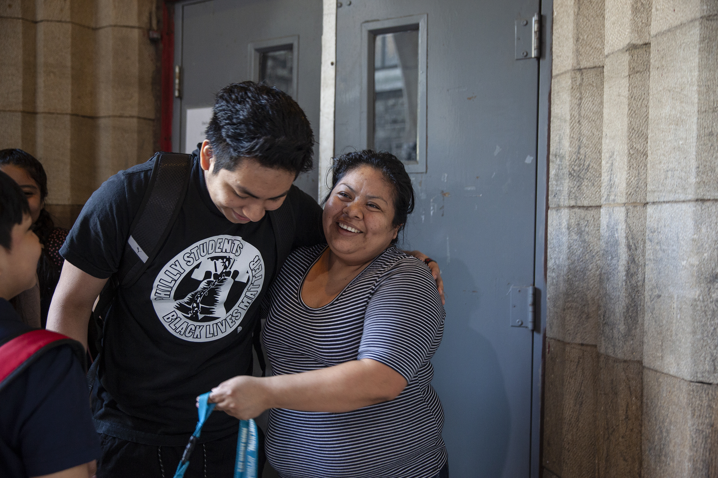 Carmela Hernandez hugs her son, Fidel, inside the gates of the Church of the Advocate in North Philadelphia before they leave sanctuary for the first day of school.