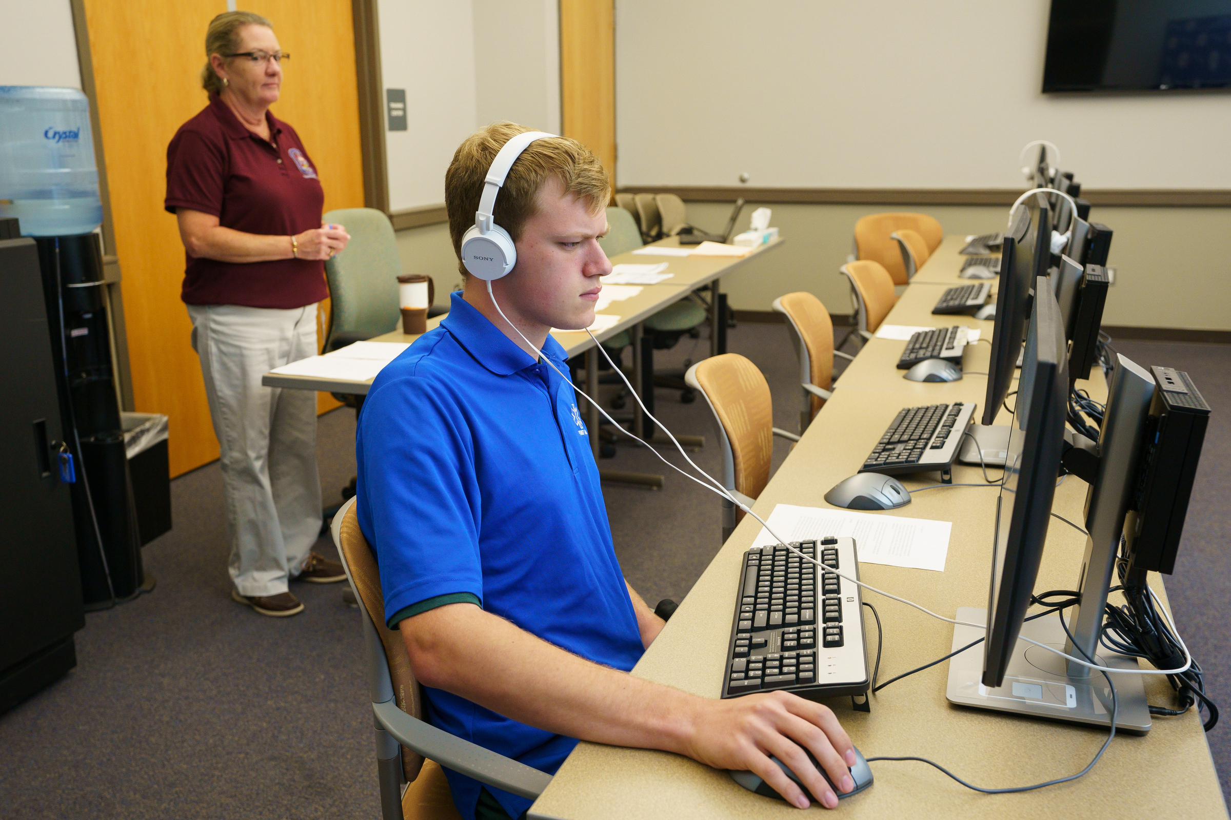 Steven Vernitsky, front center, takes a job test, as.Erin Taylor, back left, Assistant Training Coordinator of the Department of Public Safety Emergency Communications stands by, at the Montgomery County Emergency Operations Center, in Eagleville, PA., Wednesday, August 22, 2018. In the midst of a police dispatcher shortage, the Montgomery County Department of Public Safety is holding a 4-hour, no-appointment, 911 dispatcher hiring spree from 6 a.m. to 10 a.m.