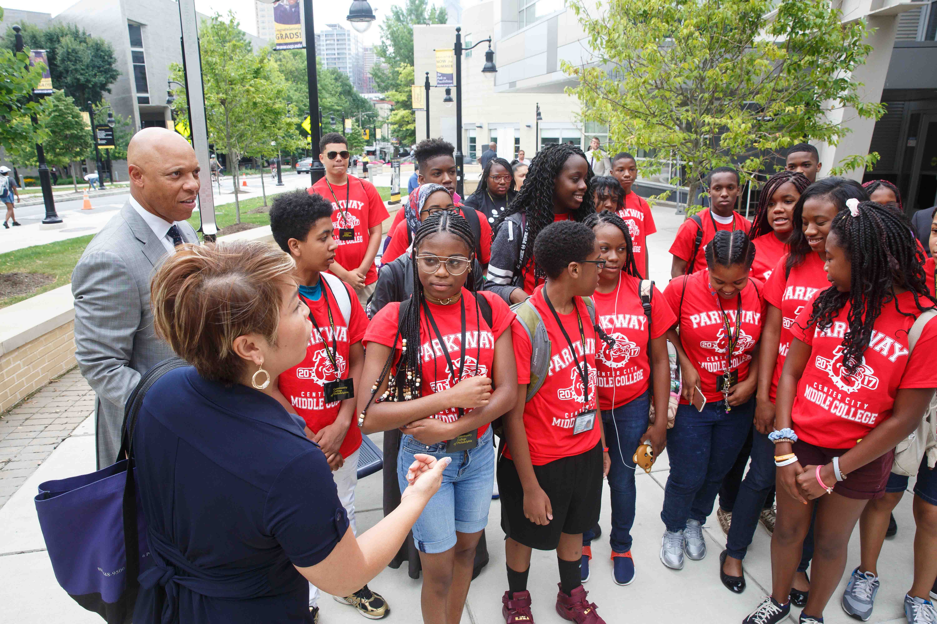Principal Anh Nguyen-Brown, of Parkway Center City Middle College, front left, and Dr. William R. Hite, Superintendent of Philadelphia Schools, back left, with students on their first day of class at Community College of Philadelphia.