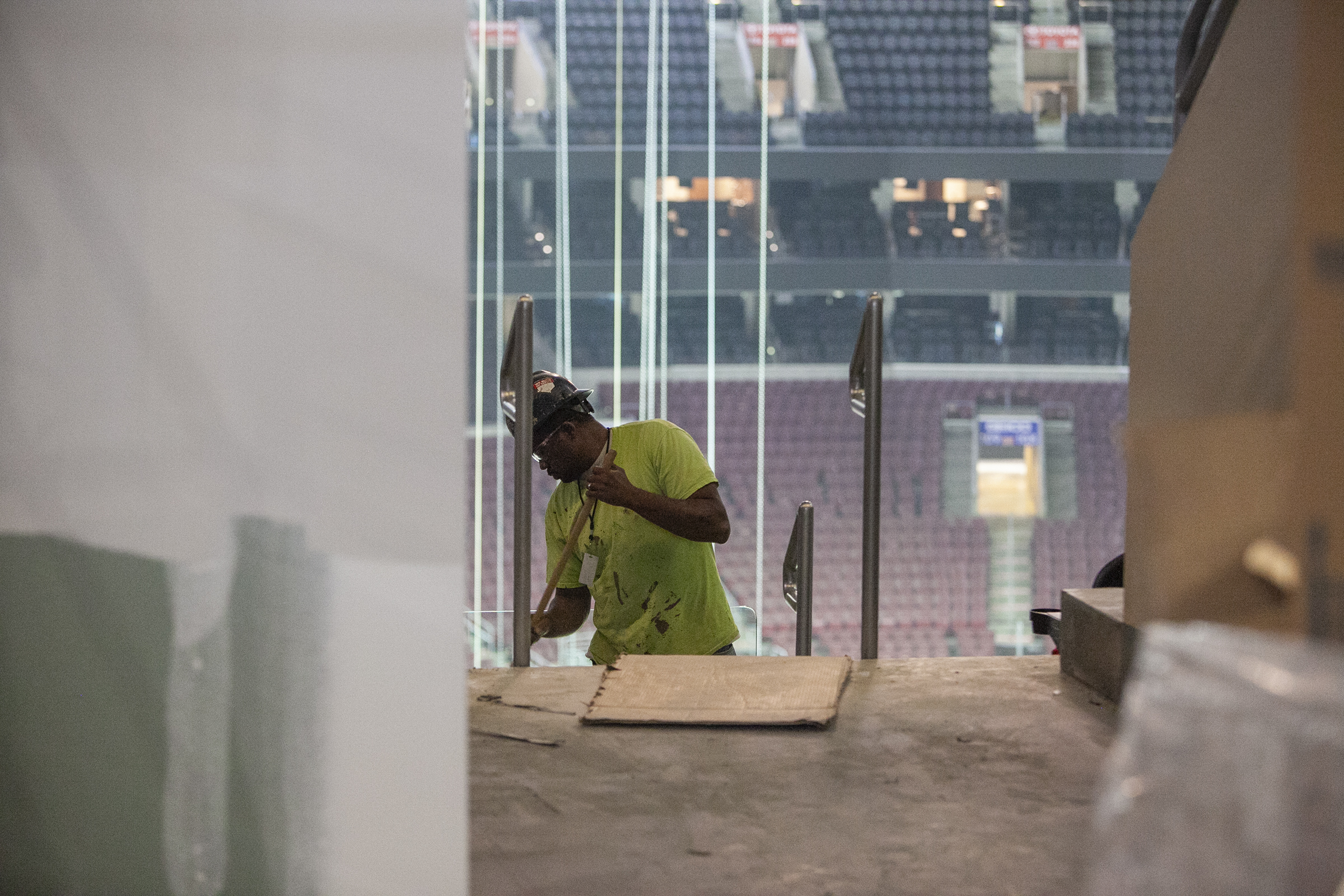 Construction crews work on the renovations inside the Wells Fargo Center on Thursday, Aug. 23, 2018.