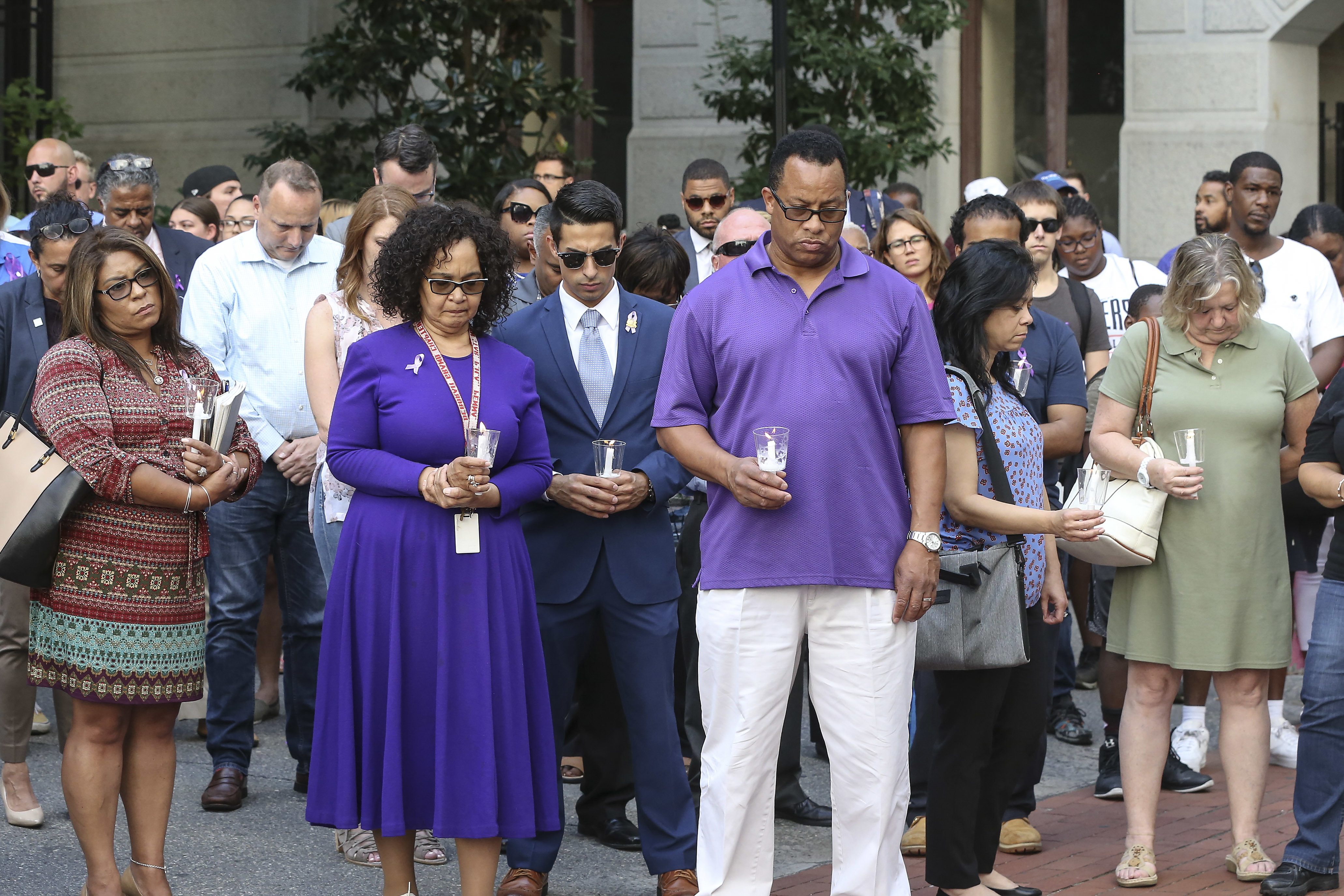 People pray during the city hall courtyard memorial vigil for Linda Rios-Neuby, the City Council staffer shot dead by her ex-husband in a murder-suicide last week. Thursday, August 23, 2018. STEVEN M. FALK / Staff Photographer