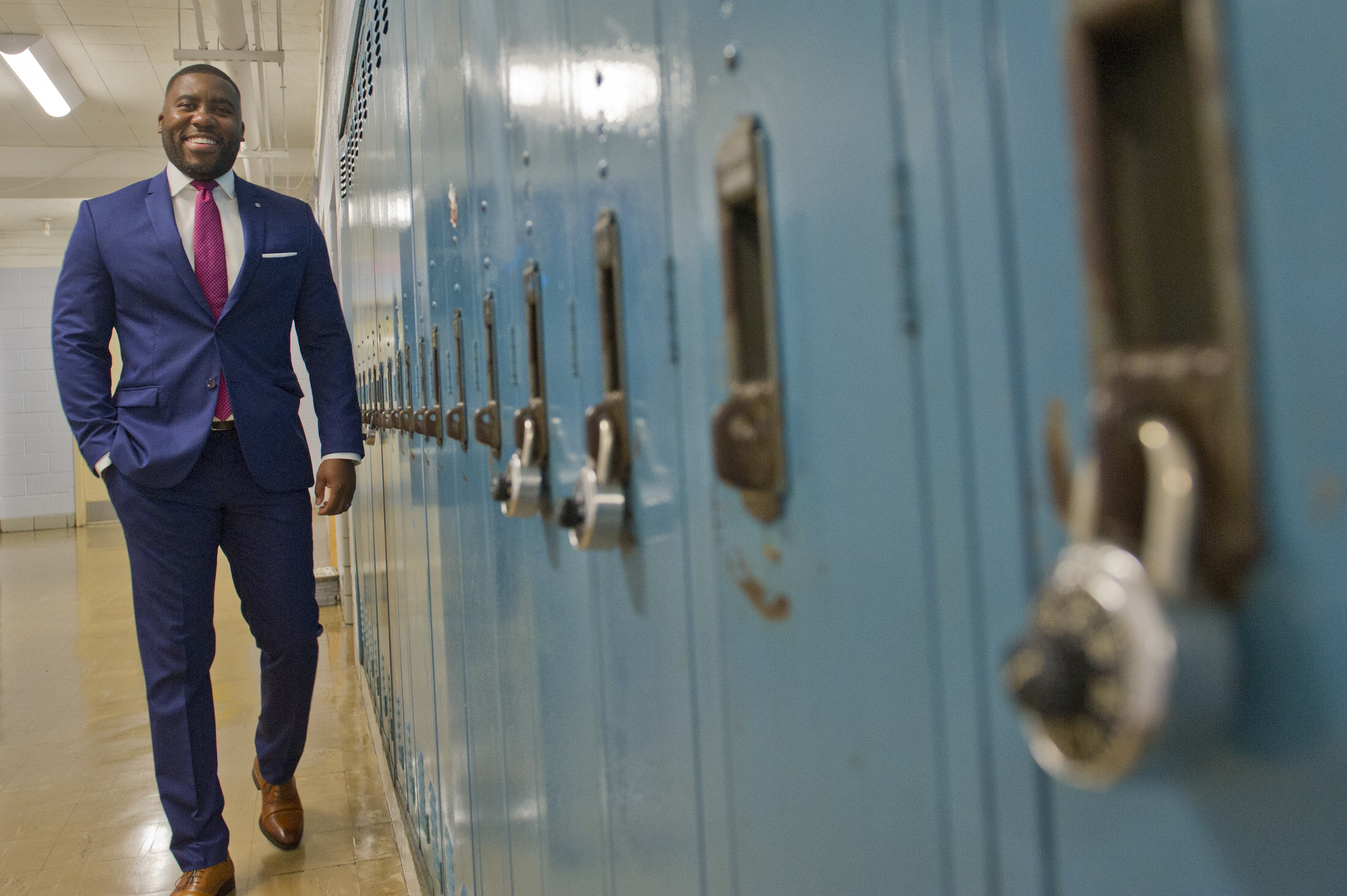 Sports marketing business teacher Howard Brown walks past a bank of lockers down the hall of Northeast High School as he prepares for this fall semester at the Philadelphia school on Friday August 24, 2018. Brown, a former exec at Goldman Sachs, made more money than he knew what to do with. But after living the high life in NYC he realized that money isn�t everything. Now, he�s back home in Philly and about to begin his second year teaching 11th and 12th graders. Avi Steinhardt / For the Inquirer