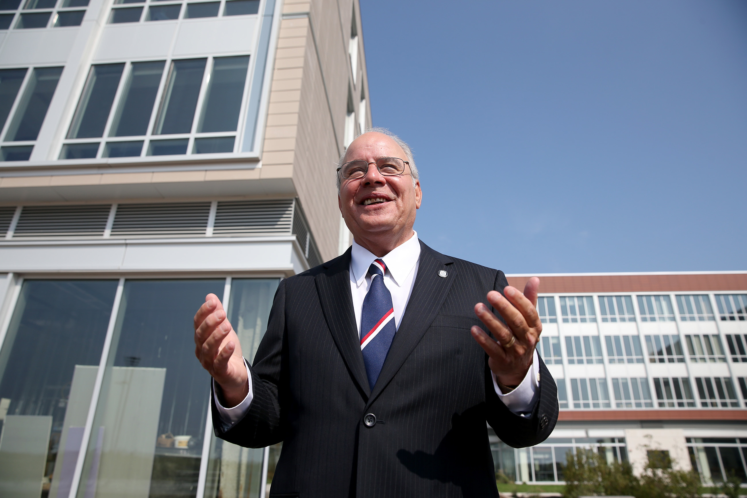 Stockton University president Harvey Kesselman begins a tour of the Stockton´s new Atlantic City campus, standing in front of the new residence hall on the beach front.