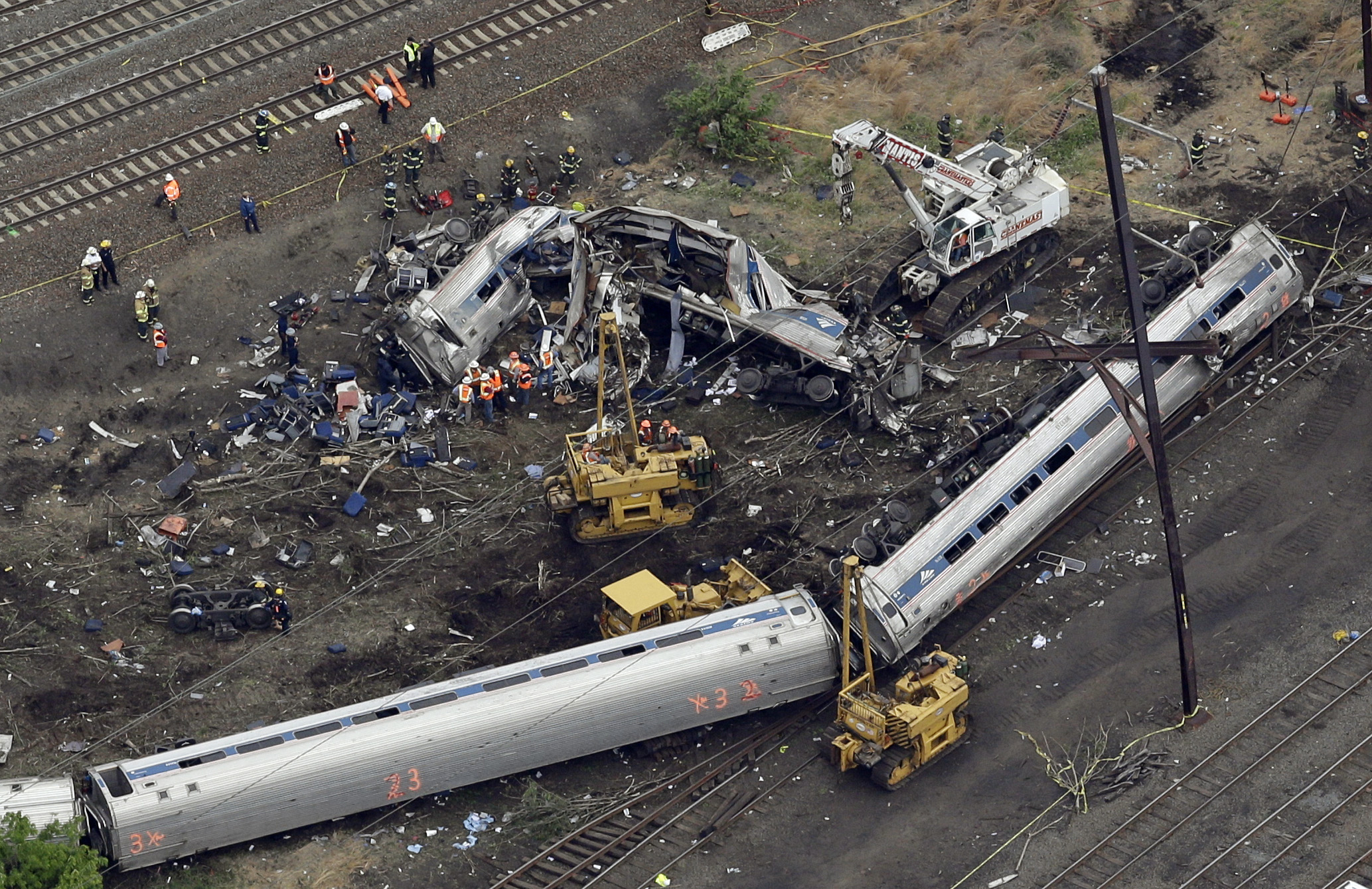 FILE – In this May 13, 2015, file photo, emergency personnel work near the wreckage of a New York City-bound Amtrak passenger train following a derailment that killed eight people and injured about 200 others in Philadelphia. The state's attorney general has a wide range of options in responding to a judge's order to arrest a speeding Amtrak engineer involved in a deadly 2015 crash, a law professor said Friday, May 12, 2017. (AP Photo/Patrick Semansky, File)