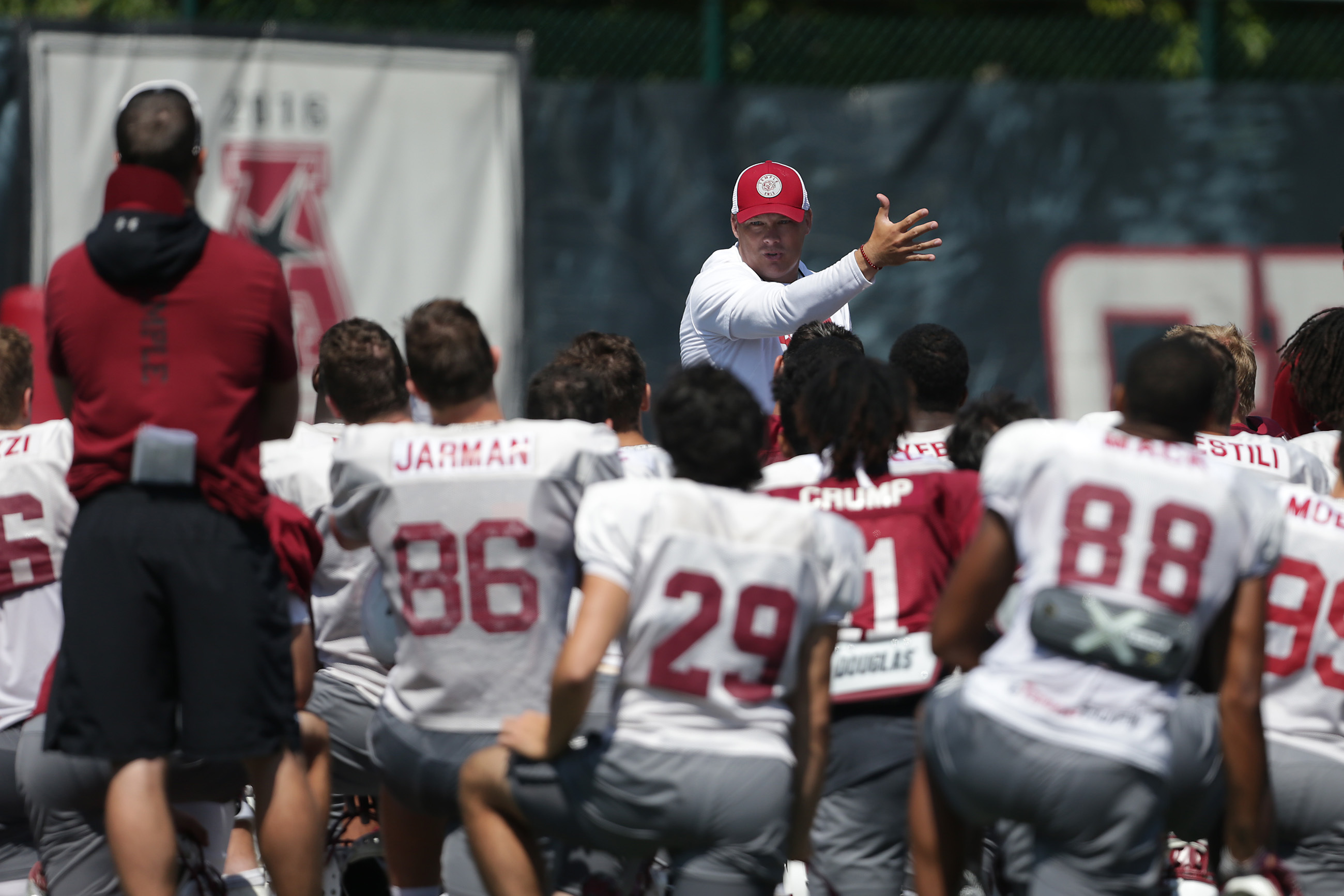 Head coach Geoff Collins, center, talks to his team during Temple´s football practice at Temple University in Philadelphia, PA on August 23, 2018. DAVID MAIALETTI / Staff Photographer