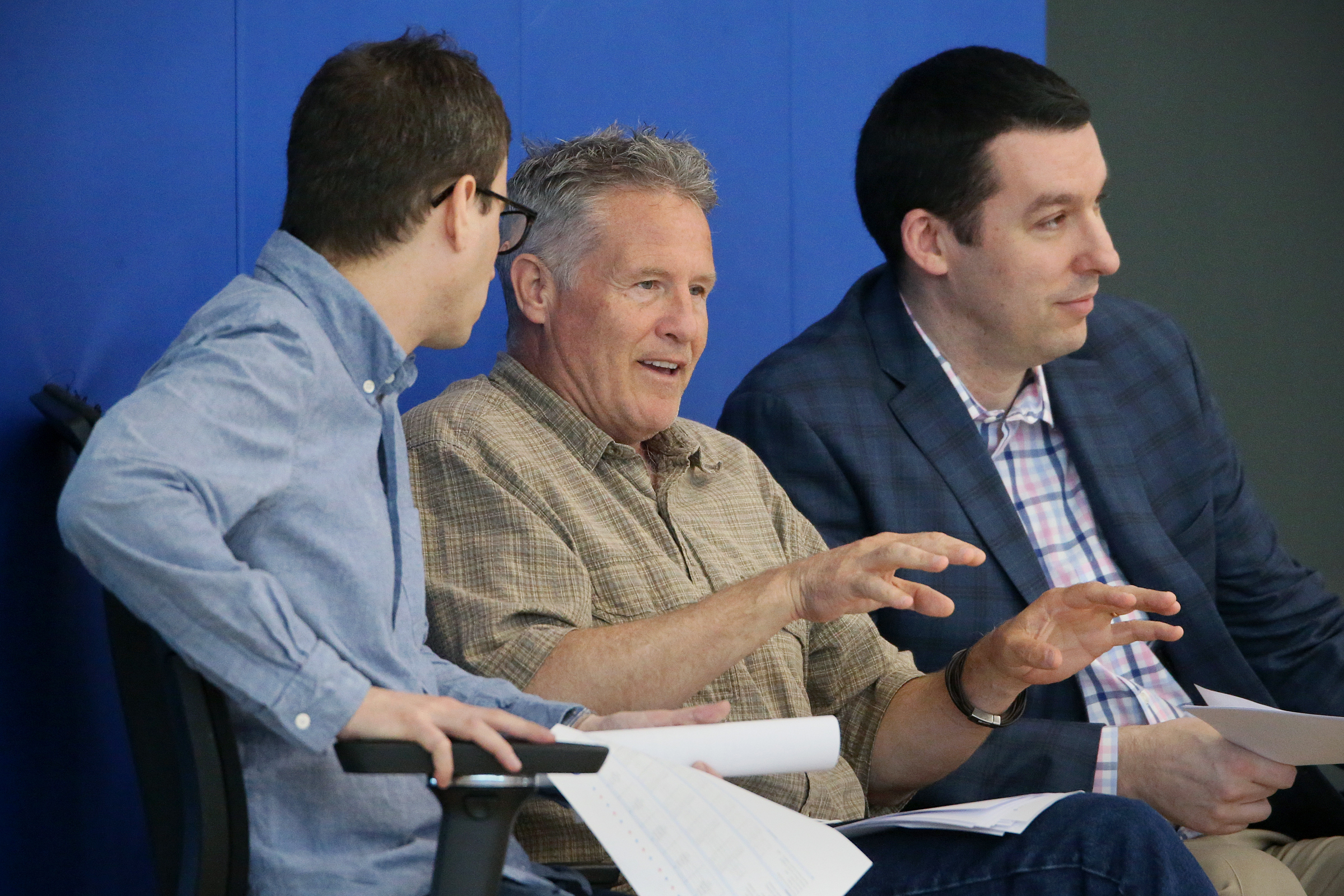 From left, Ned Cohen, Brett Brown and Alex Rucker watching prospects during a pre-draft workout in June.