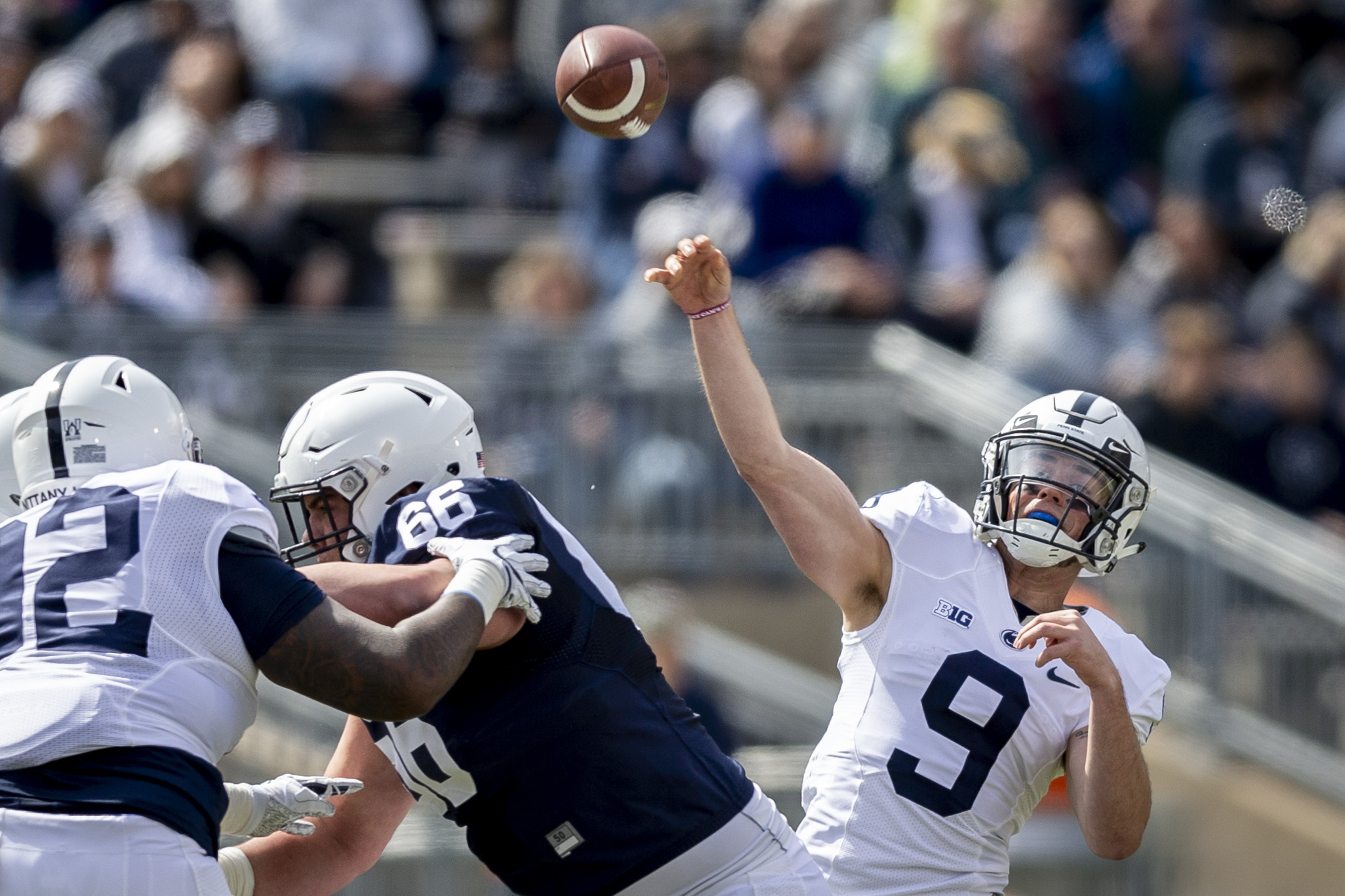 File-This April 21, 2018, file photo shows Penn State quarterback Trace McSorley, right, throwing during the first quarter of the Blue-White spring college football game in State College, Pa. McSorley has a career completion rate of 61.8 percent and has thrown a TD pass in 28 straight games, the longest active streak in the FBS. (Joe Hermitt/PennLive.com via AP, File)