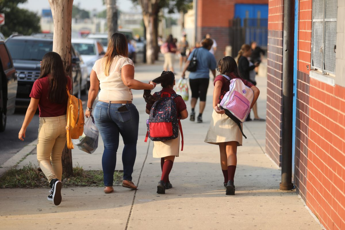 Students arrive for first day of school at the Luis Munoz-Marin School in North Philadelphia Monday morning.