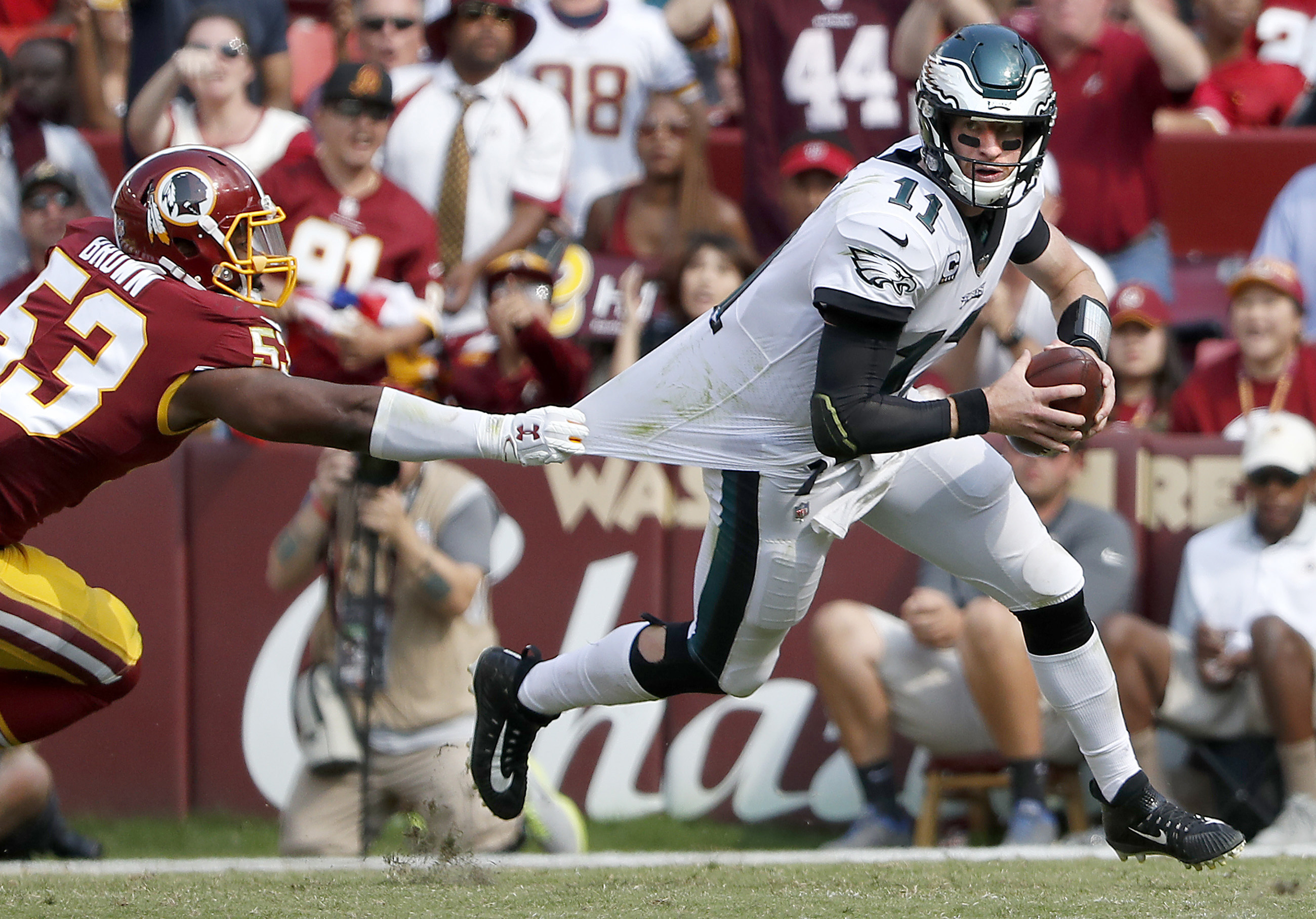 Carson Wentz scrambles away from the Redskins' Zach Brown last September. The Eagles don´t face their divisional rival until December this season.