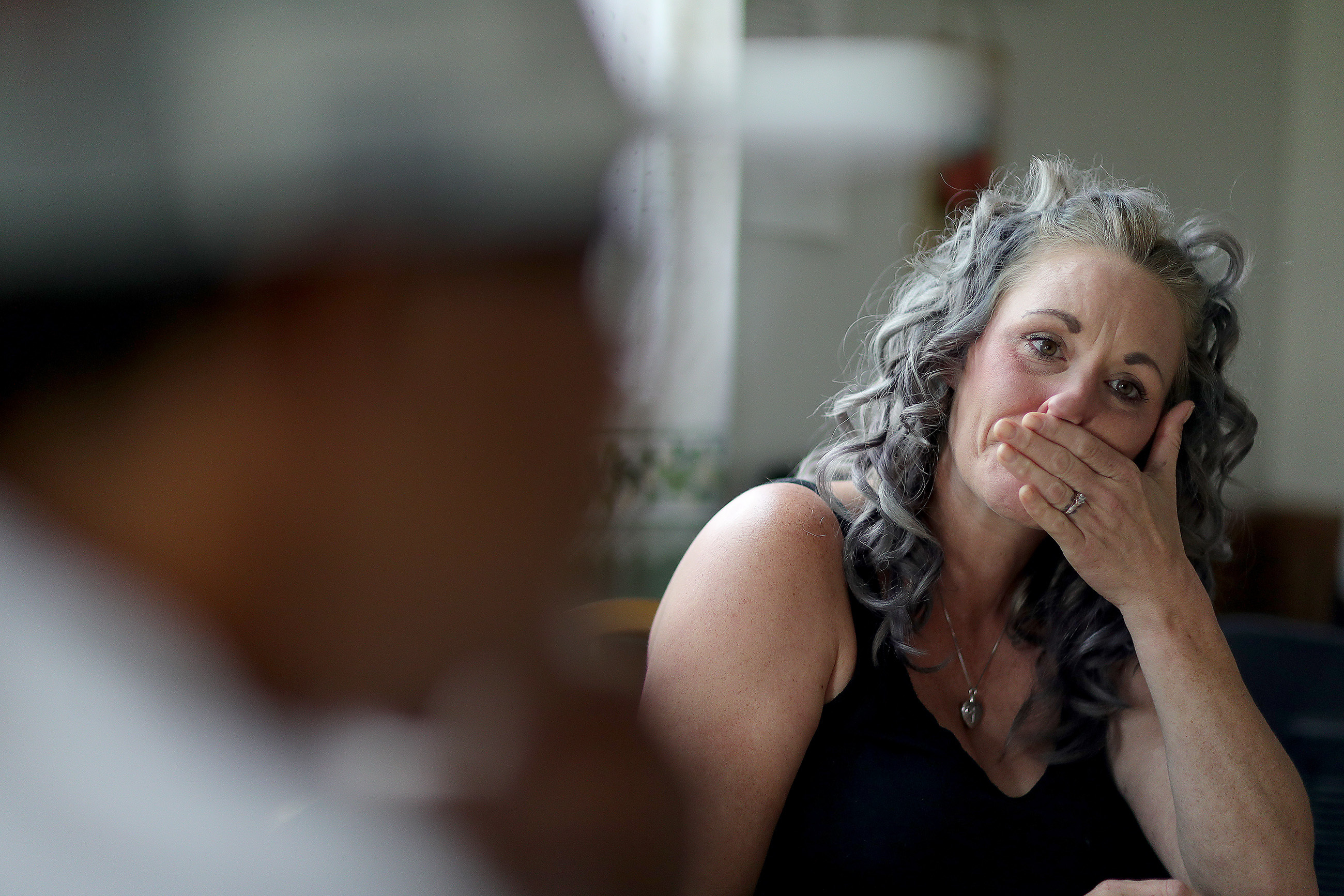 Lisa Geist cries as she talks about her 17 year-old daughter, Brieze McCabe, in Kulpmont, PA on July 5, 2018. Her daughter died of an apparent drug overdose. The parents struggled to help her when they found out last fall that she was using heroin.