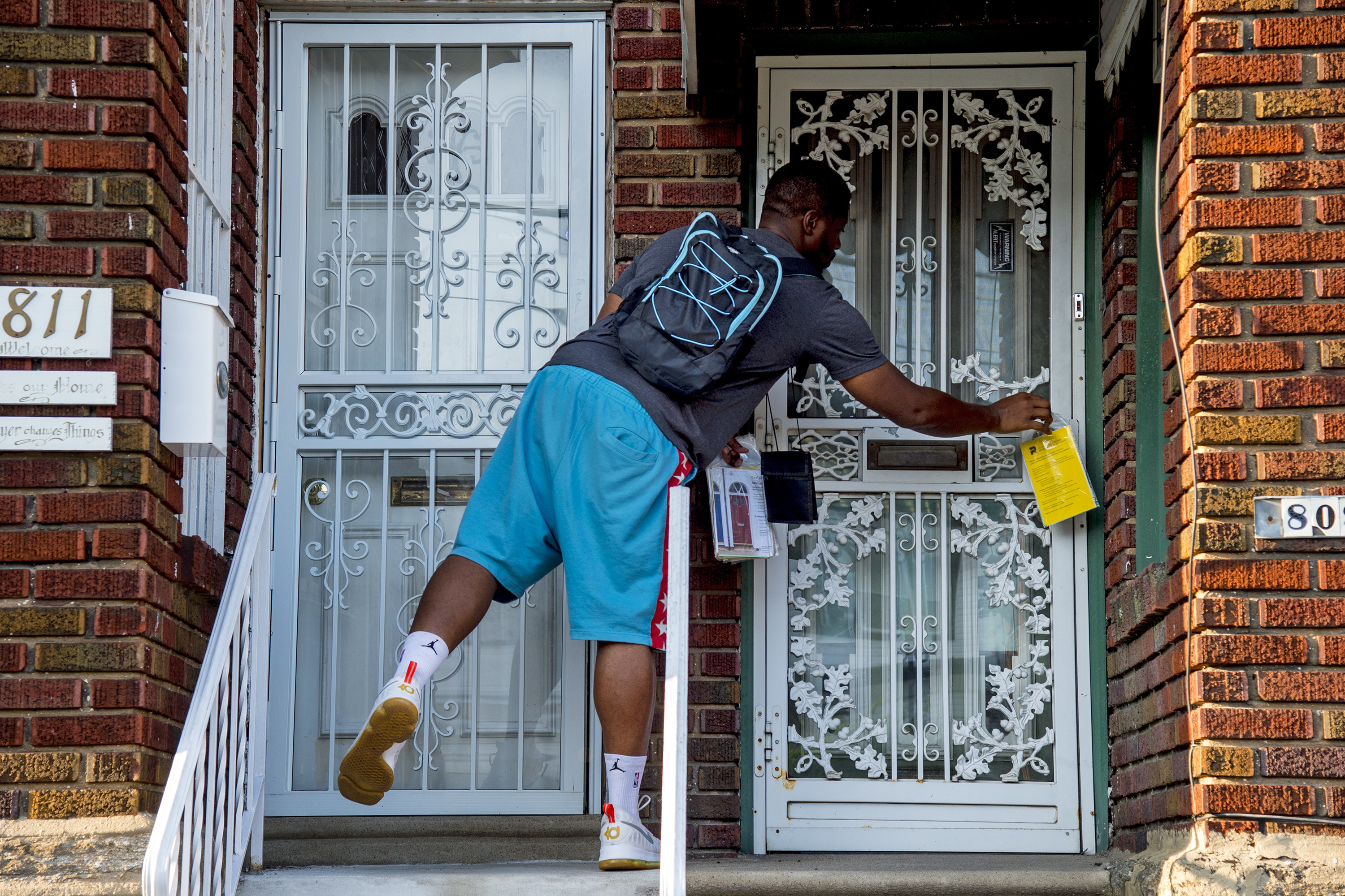 Eddie Howard, a canvasser with Community Marketing Concepts, a marketing consultant group contracted by the city´s Department of Revenue, goes door-to-door in West Oak Lane, leaving information packets and talking to homeowners about tax relief programs.