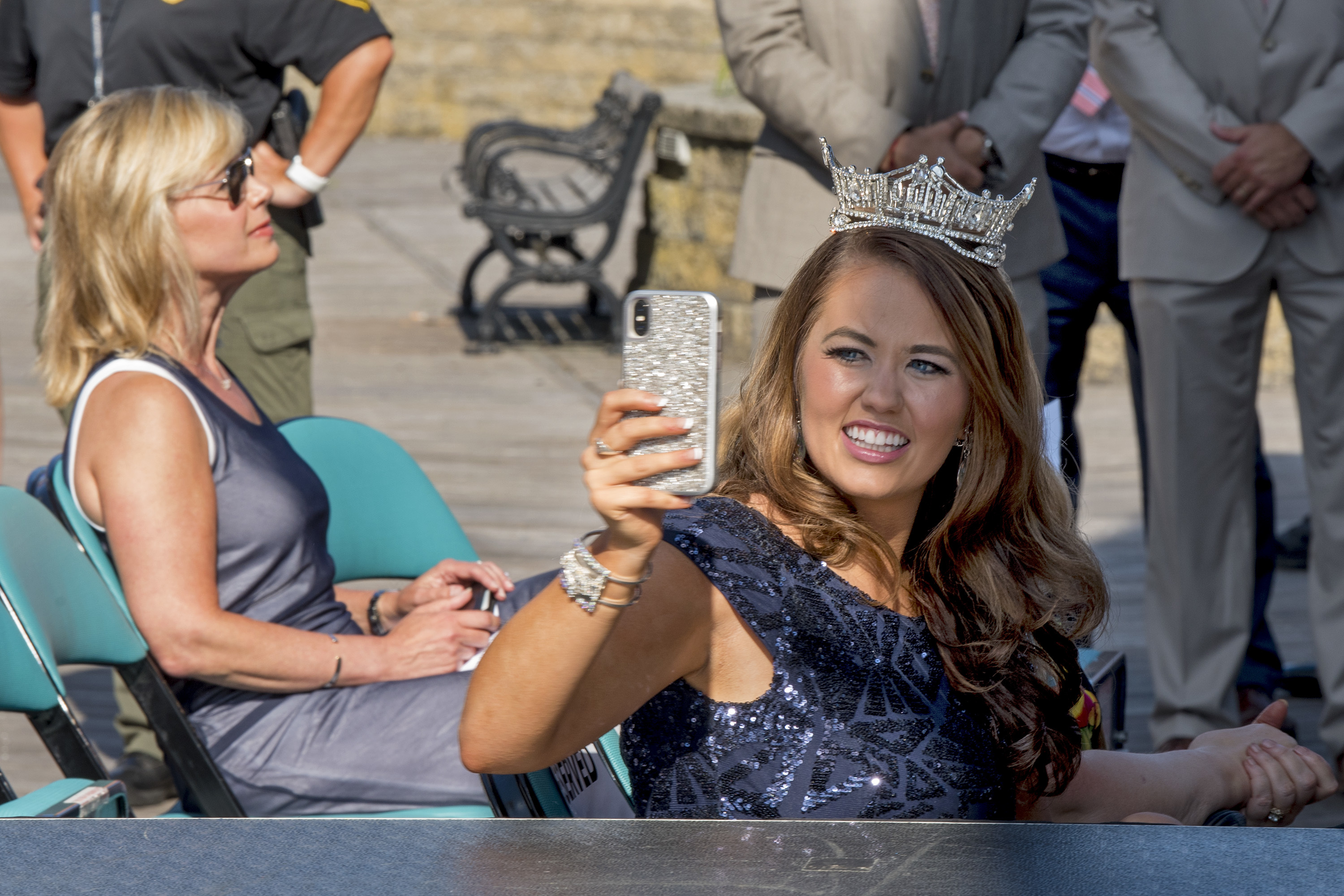 Miss America board chair Gretchen Carlson (left) is seated a row behind Miss America 2018 Cara Mund (right) during ceremonies as the Miss America contestants arrive on the Boardwalk in Atlantic City to kick off the 2019 pageant August 30, 2018. Earlier this month, Mund wrote a public letter criticizing Carlson and the Miss America organization. The two did not interact during the event.