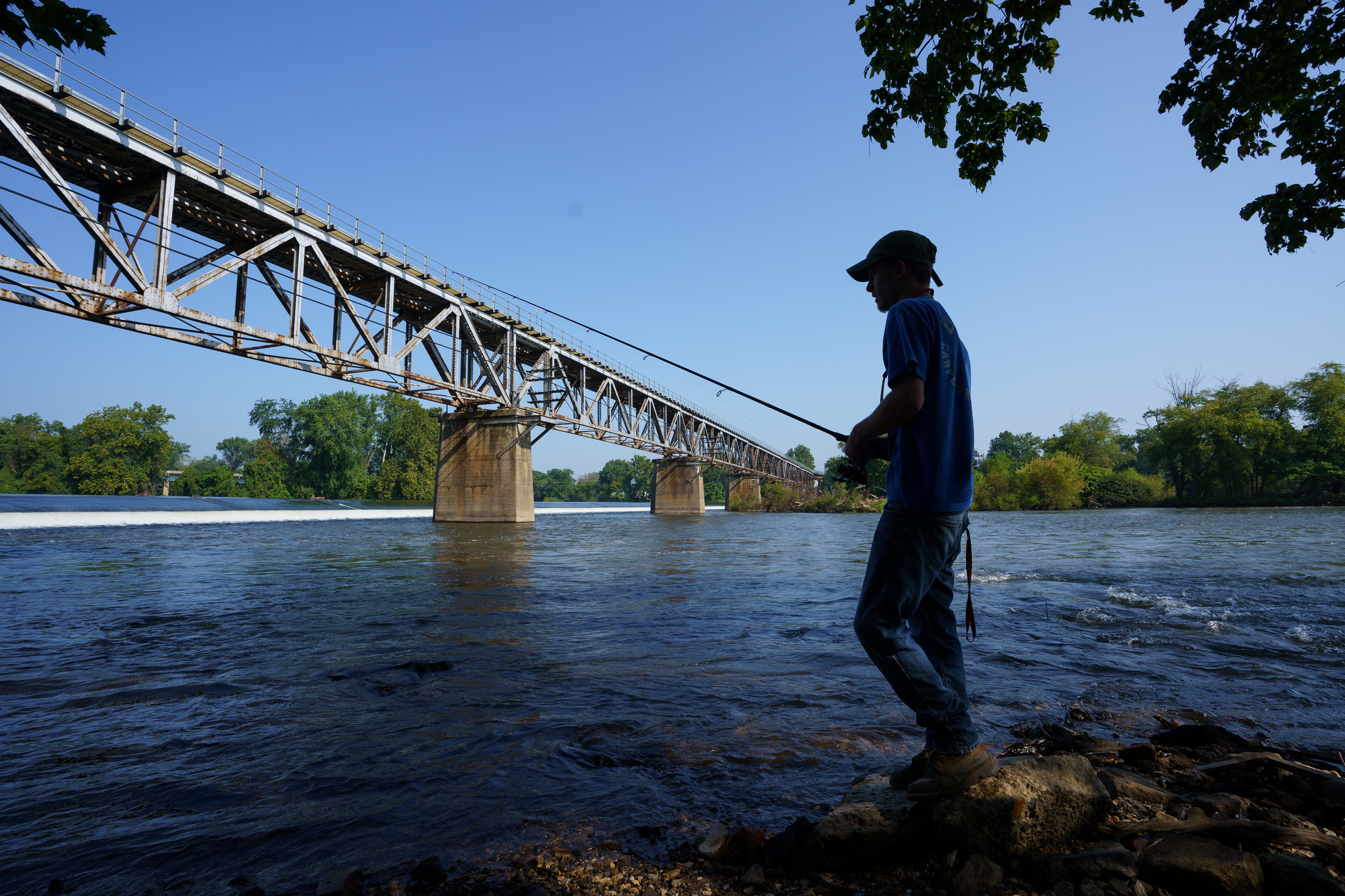 Kevin Rodenbaugh, 20, of King of Prussia, who recently caught a 45-inch Muskie in the Schuylkill, shown here fishing off the banks of the Schuykill River, near Bridgeton, PA, Tuesday, August 28, 2018. JESSICA GRIFFIN / Staff Photographer
