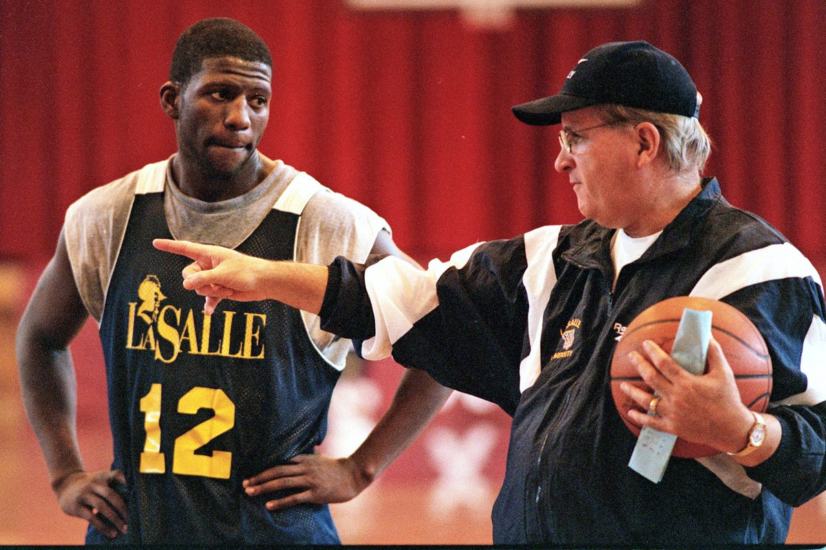Donnie Carr receiving instruction from La Salle coach Speedy Morris during a 1997 practice.