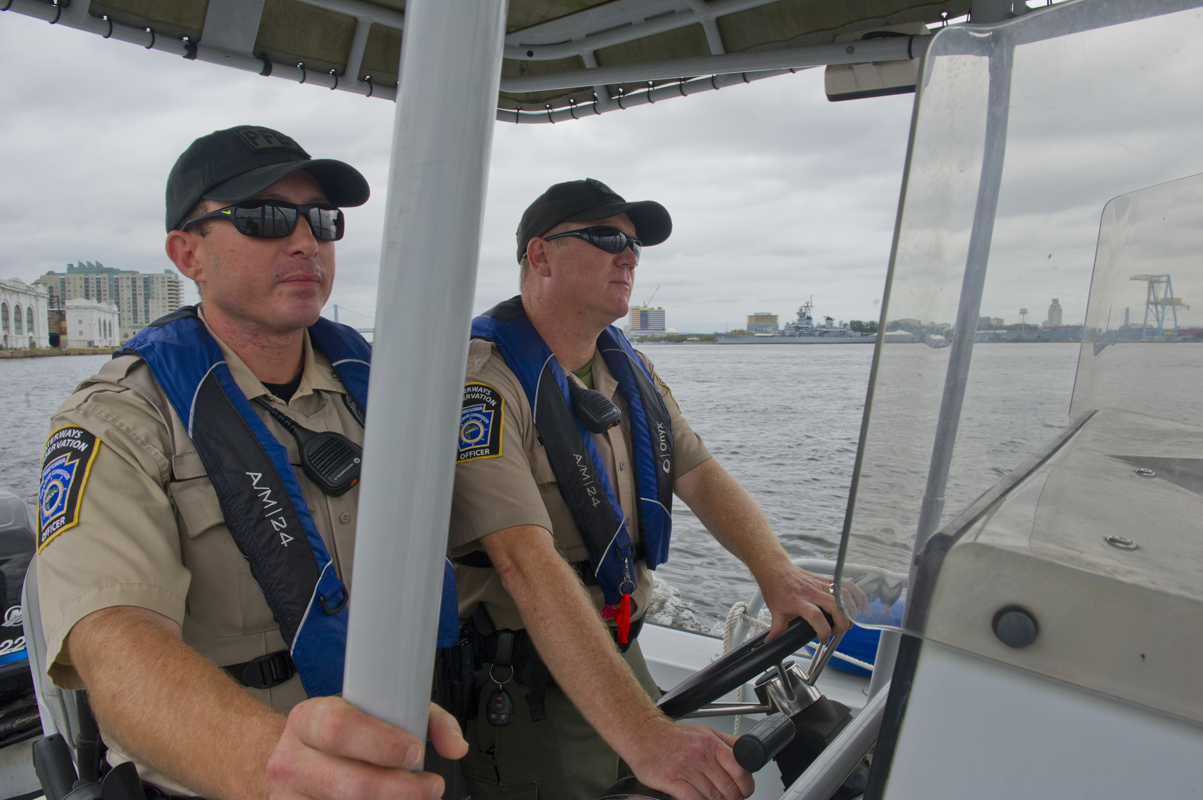 PA. Fish and Boat Commission Waterway Conservation Officers Michael Blair (left) and Nathan Hancock on the Delaware River.