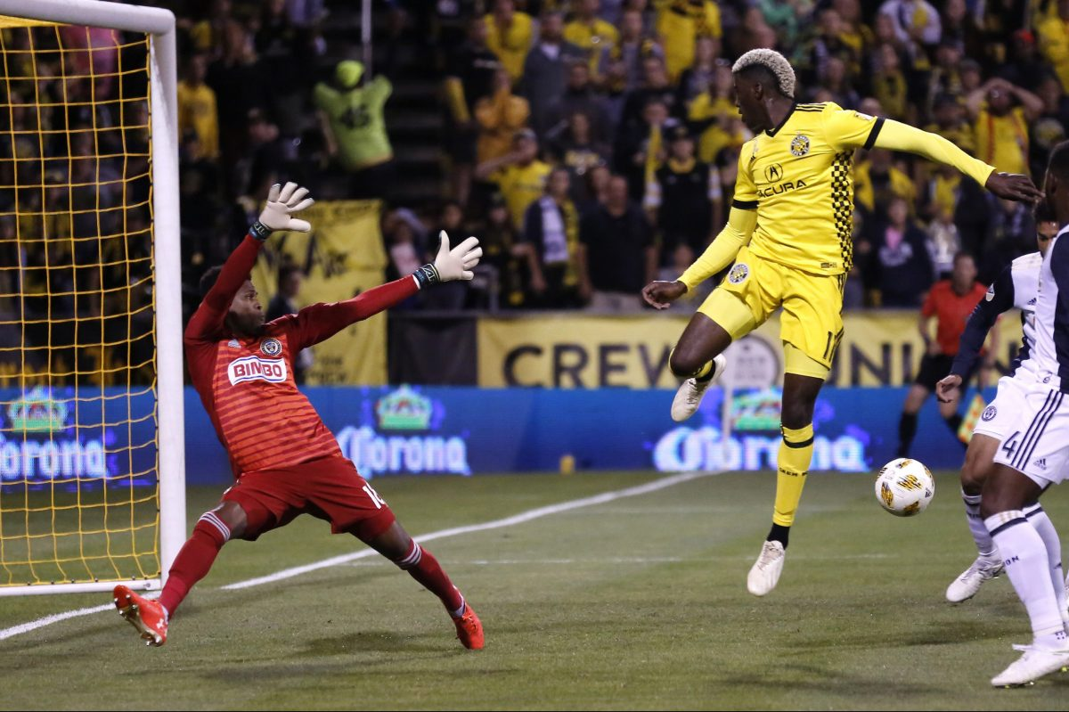 Union goalkeeper Andre Blake (left) blocks the shot of Columbus Crew forward Gyasi Zerdes during the first half of the Union's tie on Saturday.