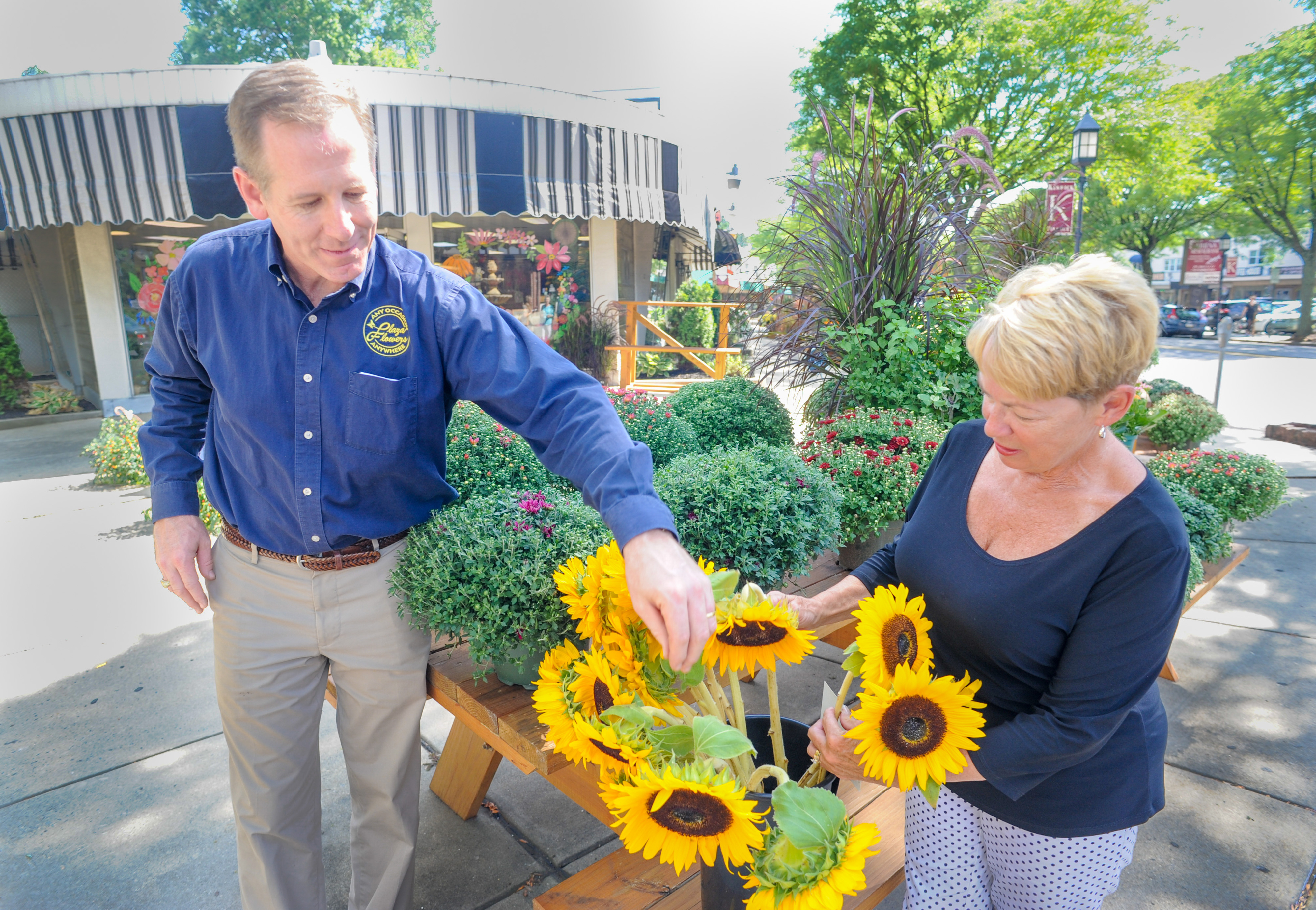 From left, new owner Chris Drummond and Dottie Pannepacker look at some sunflowers at Penny´s Flowers Tuesday, September 04, 2018 in Glenside, Pennsylvania.