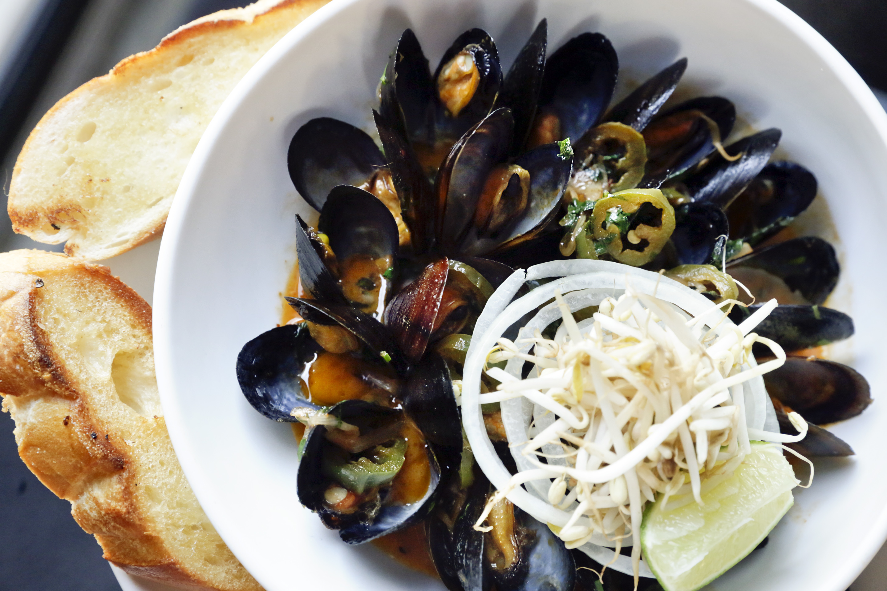 The pho mussels (lemongrass beef broth, bean sprouts, thai basil, jalapeno, sriracha butter) at Chick´s.