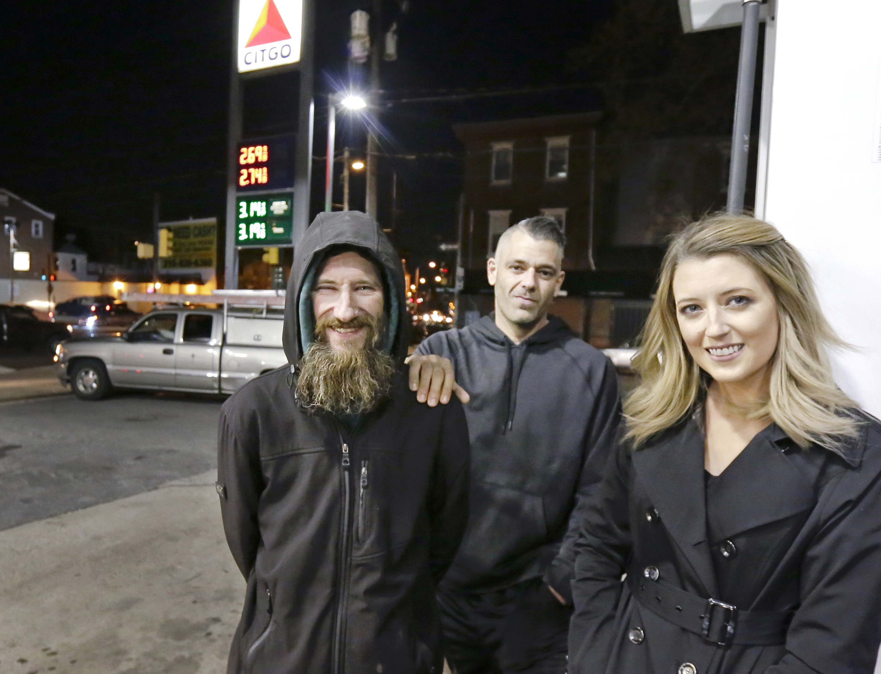 Johnny Bobbitt Jr., left, Kate McClure, right, and McClure´s boyfriend Mark D´Amico at a Citgo station in Philadelphia during happier times in November.
