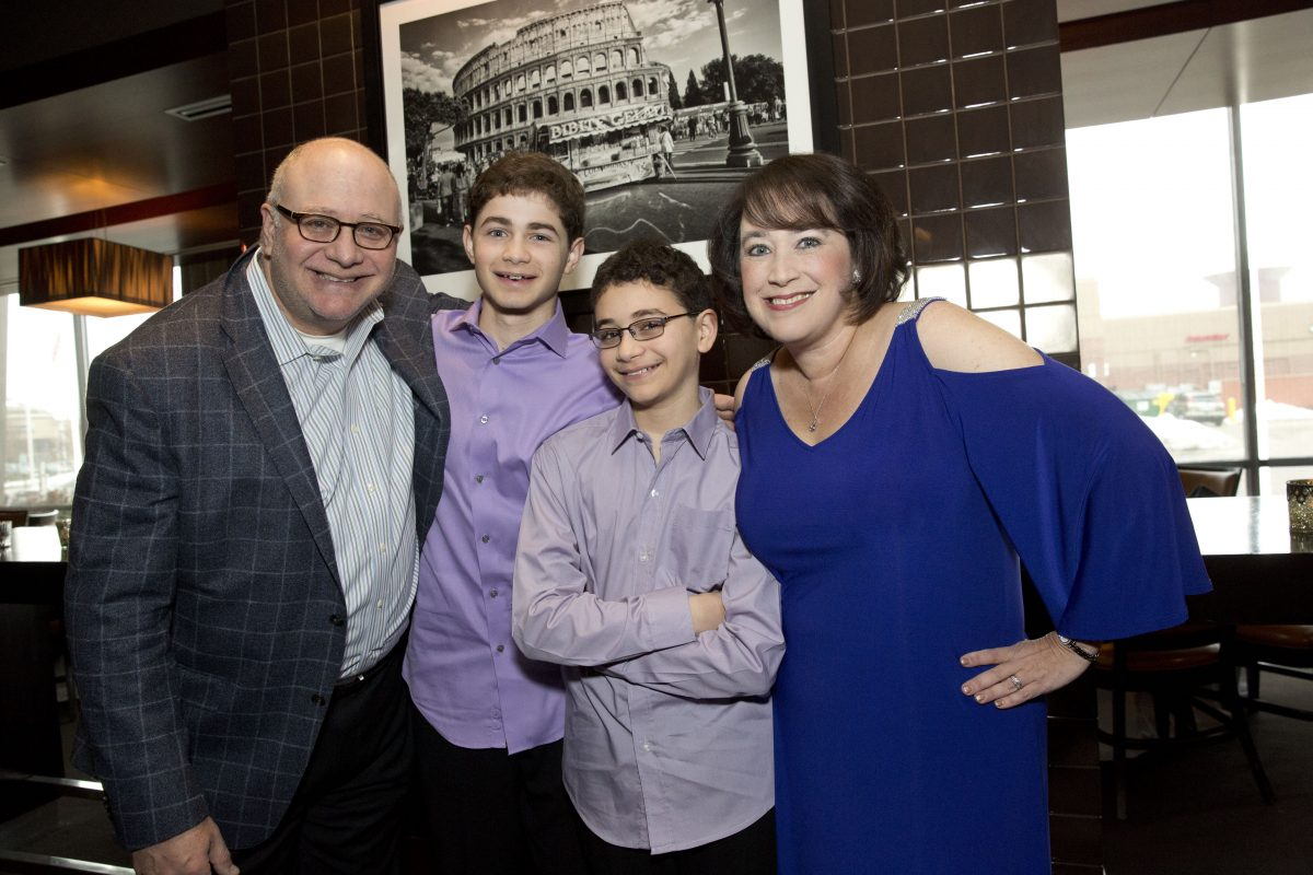 Ivy Elkins with her husband Ben and their sons Adam, 16, and Jared, 14.
