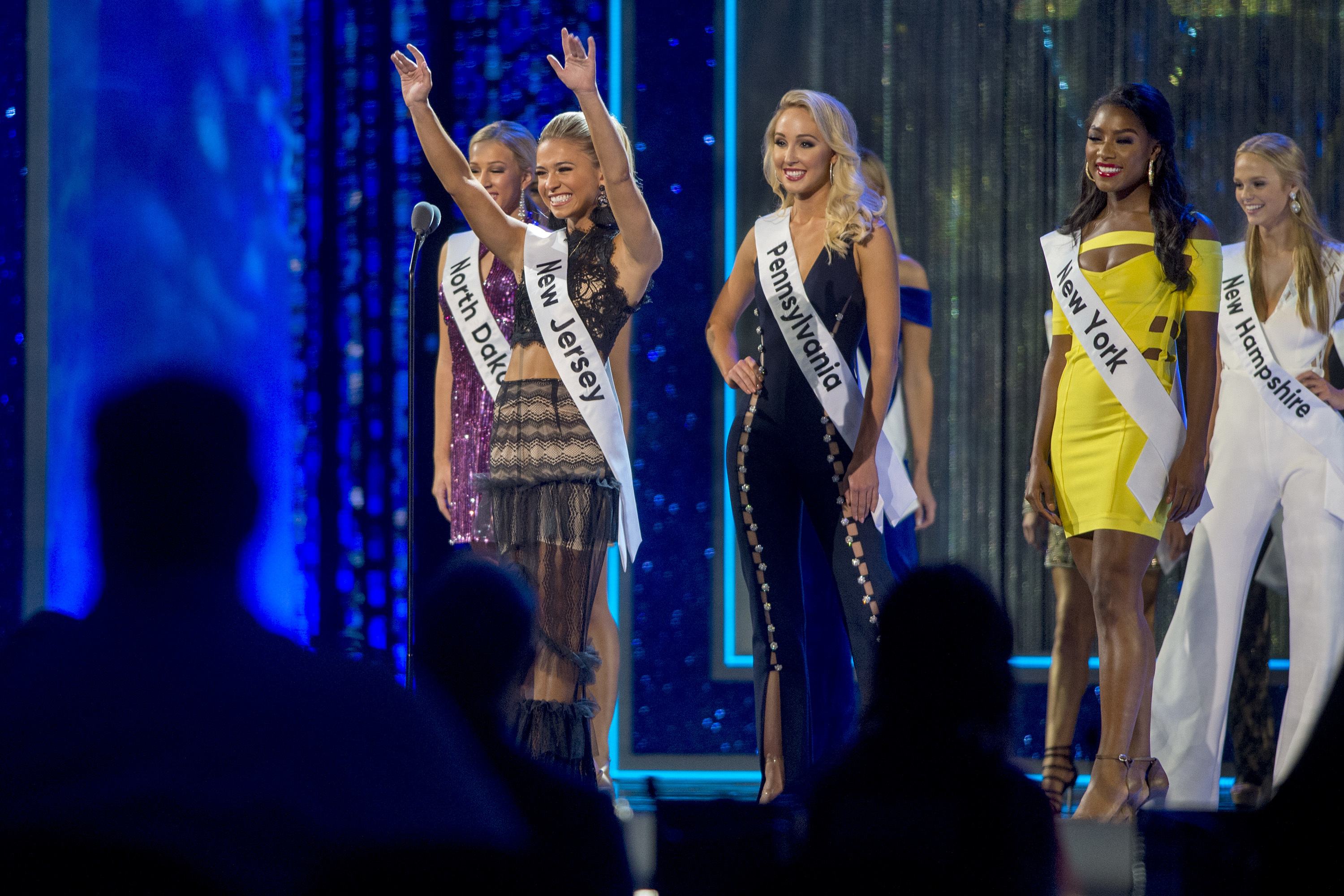 Miss New Jersey Jaime Gialloreto waves to the audience during the opening of the first preliminary night of the Miss America 2019 competition at Boardwalk Hall in Atlantic City, September 5, 2018. Behind her are Miss North Dakota Katie Olson (from left) Miss Pennsylvania Kayla Repasky, Miss New York Nia Franklin, and Miss New Hampshire Marisa Moorhouse.