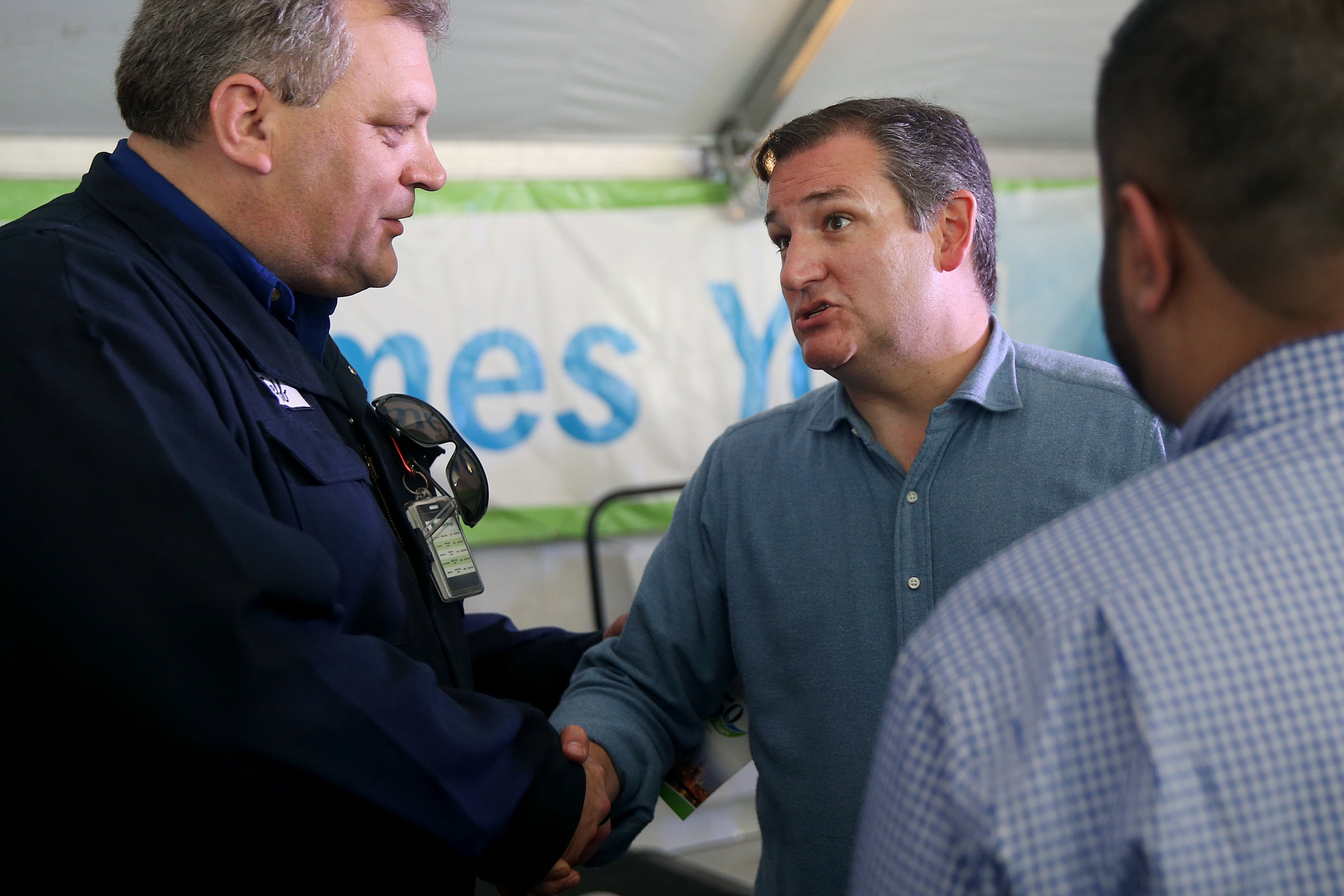 U.S. Sen. Ted Cruz (R-Texas), right, shakes hands with Monroe Energy President and CEO Jeff Warmann after a rally against the federal renewable fuel standard program at the Philadelphia Energy Solutions refinery on Wednesday, Feb. 21, 2018. PES, which filed for bankruptcy in January, blames its financial situation on the rising price for renewable energy credits mandated by the renewable fuel standard program. TIM TAI / Staff Photographer
