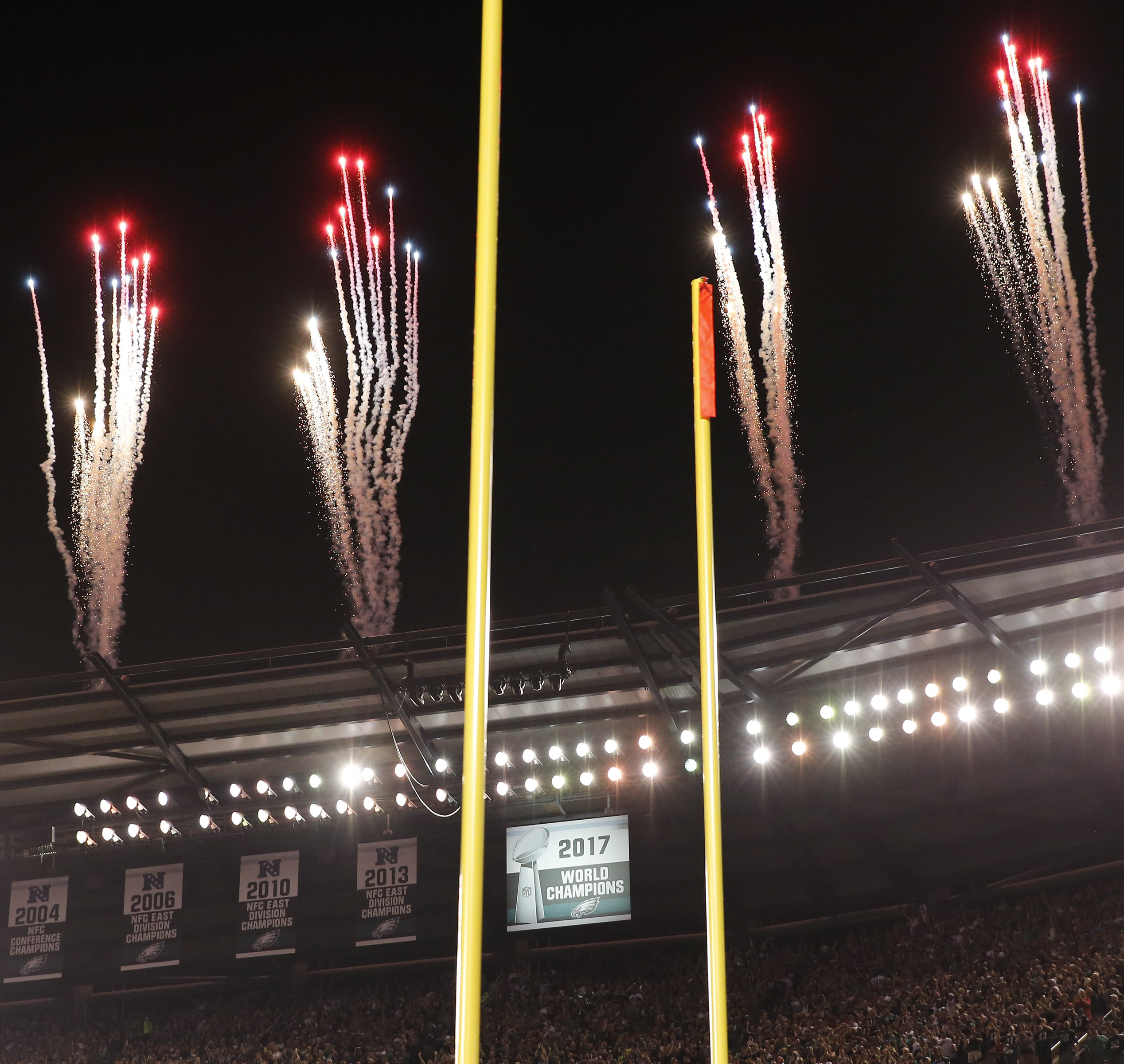 Fireworks fly past the Eagles Super Bowl banner ahead of Thursday´s game.