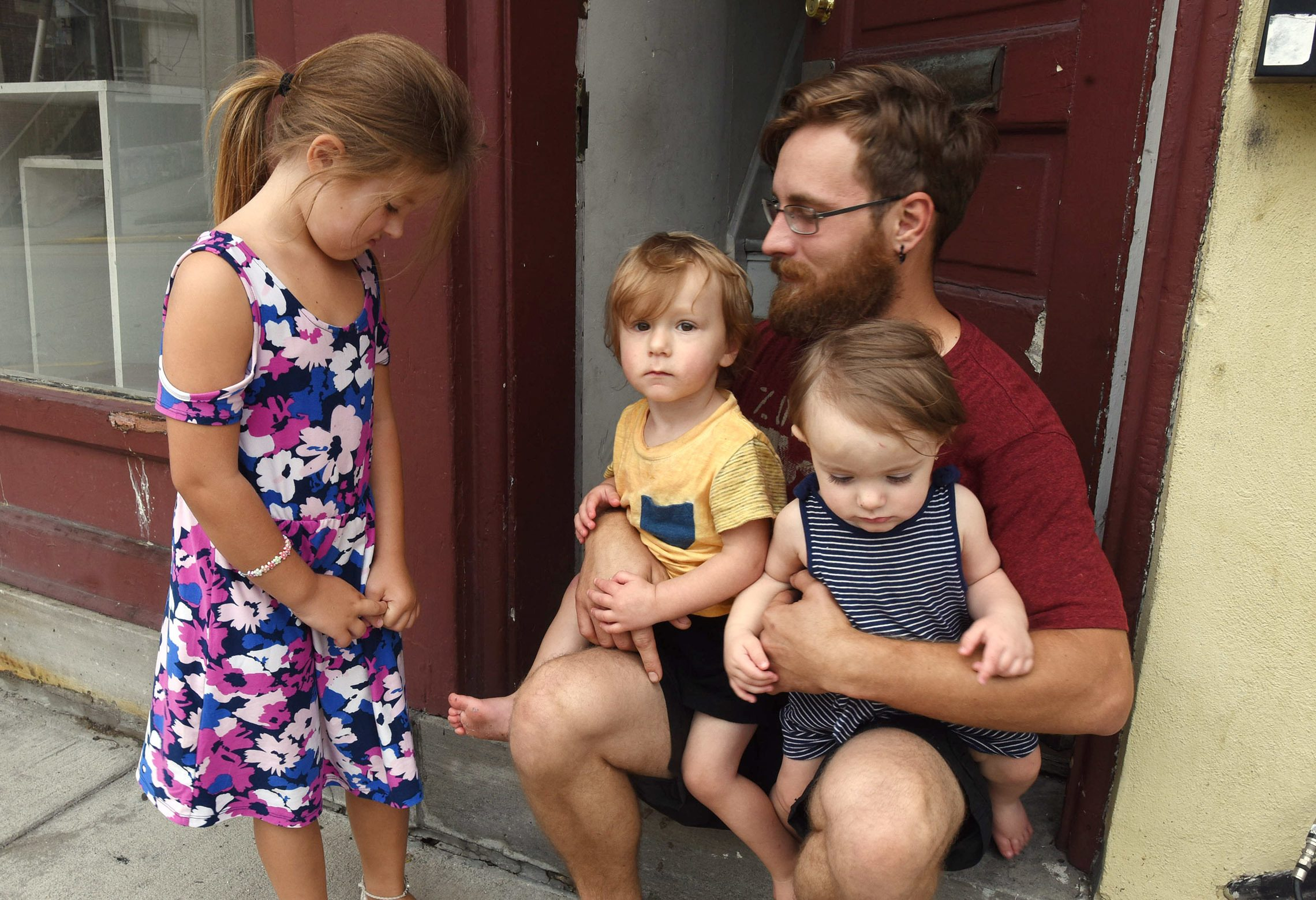 Michael Casner is shown with his three children, Isabella, left, Christian, center and Peyton, right, Saturday SEPT 1, 2018 in Spring City, Pa.