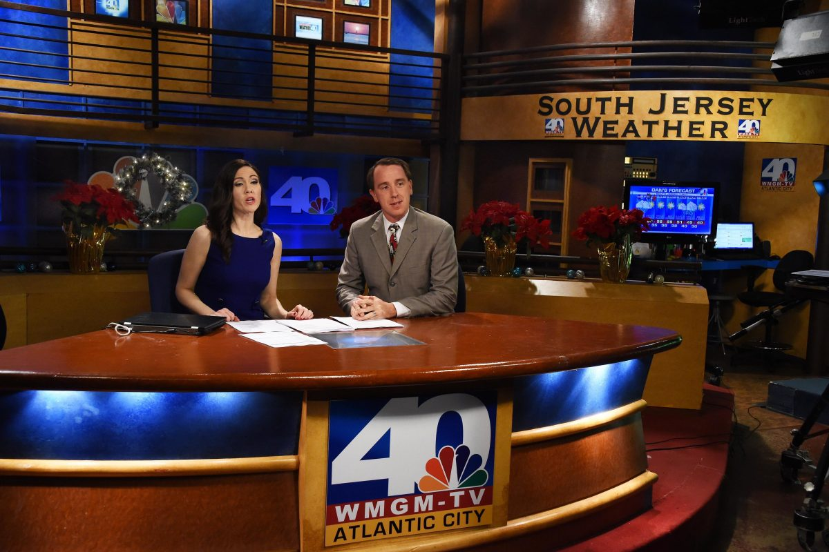 Former NBC40 news anchor Michelle Dawn Mooney, left, and weatherman Dan Skeldon offer up the 5 p.m. local news on the station on Dec. 23, 2014.  The station lost its NBC license and was later went dark.