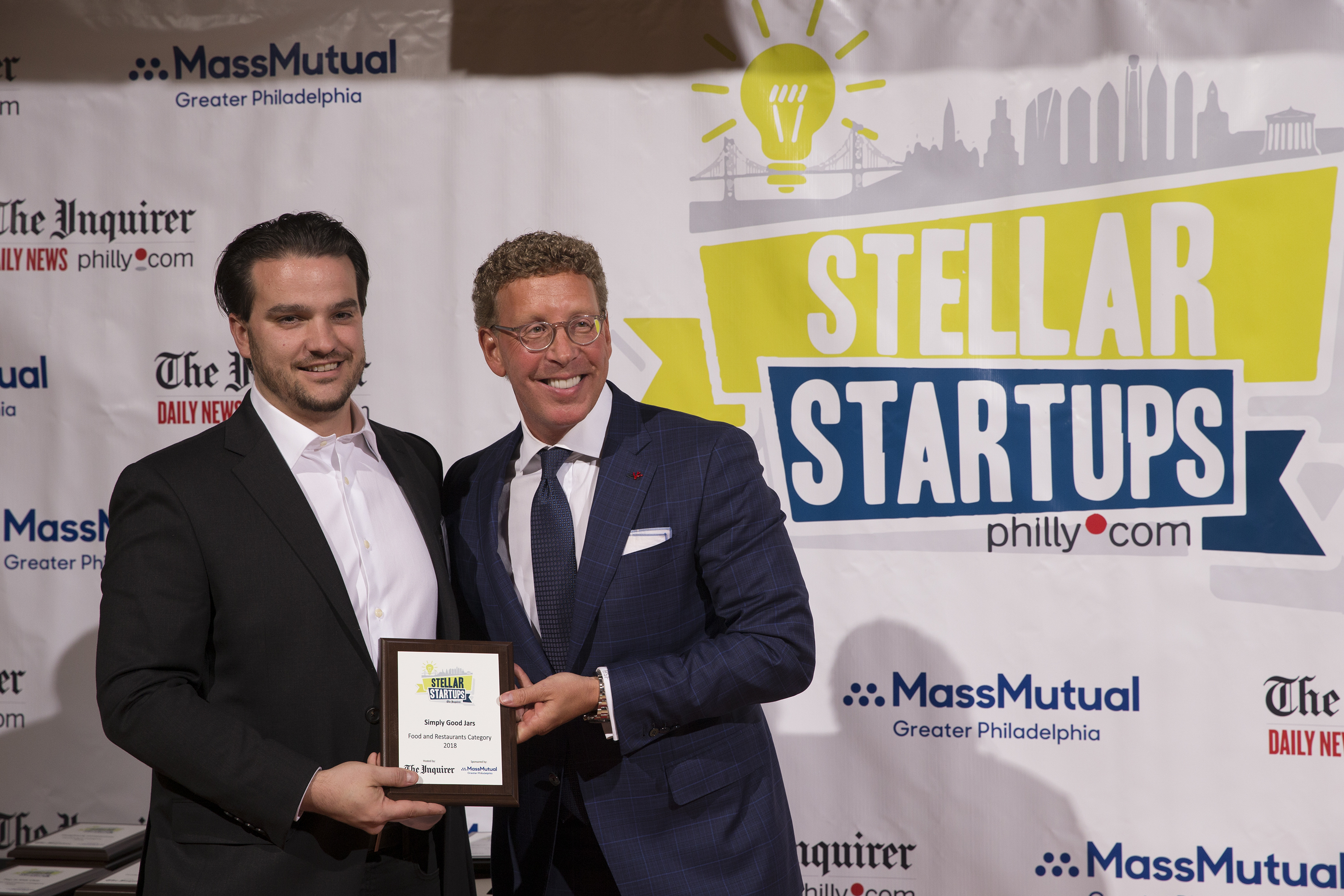 The winner of the food category is Simply Good Jars, CEO Jared Cannon (left) accepts the award from Harris Fishmen, president and CEO of MassMutual Greater Philadelphia.