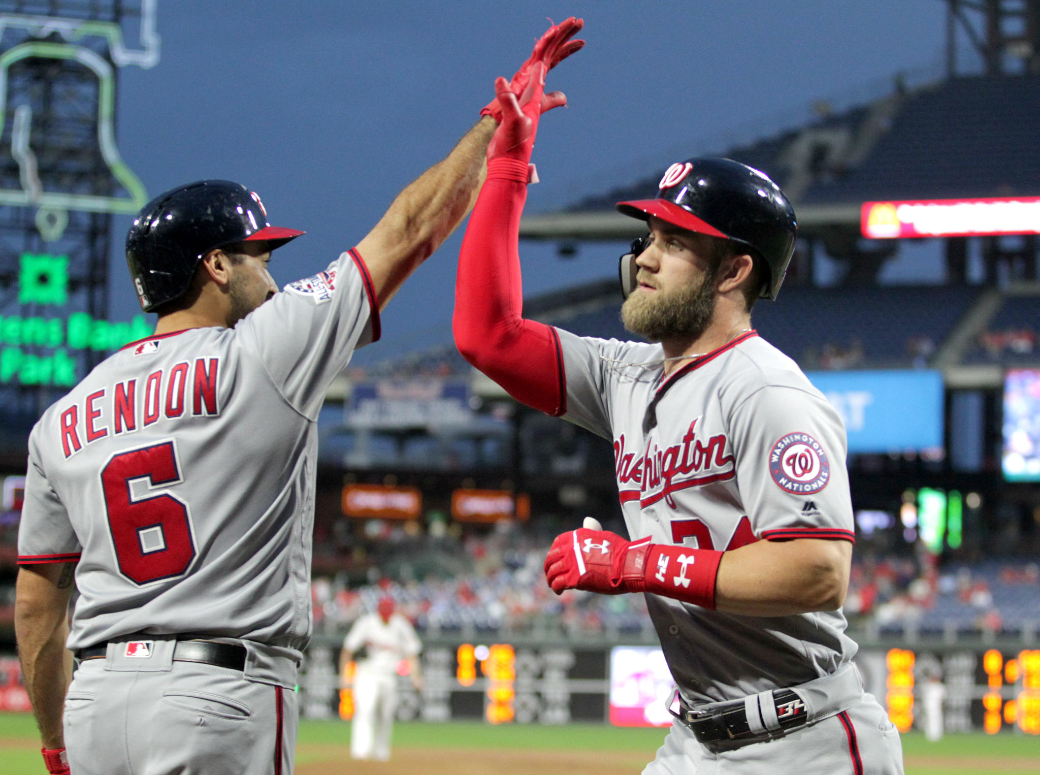 Bryce Harper, right, of the Nationals is congratulated by Anthony Rendon after his 2-run home run in the 1st inning against the Phillies at Citizens Bank Park on Sept. 12, 2018.