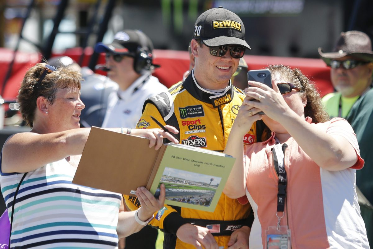 Erik Jones posing for a selfie with a fan before a practice earlier this summer.