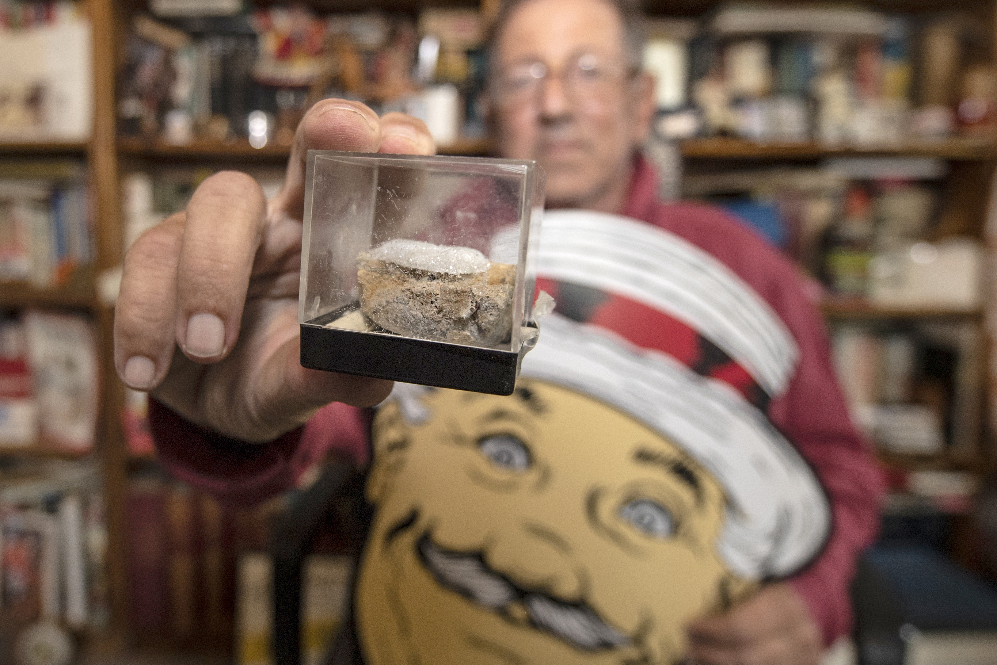 Robert Strauss shows a souvenir fragment of pavement from the notorious Ellisburg Circle in Cherry Hill. Strauss, a writer, grew up in the township and has collected some memorabilia of its postwar boom years. He regards the changes brought about by redevelopment as part of Cherry Hill´s DNA.