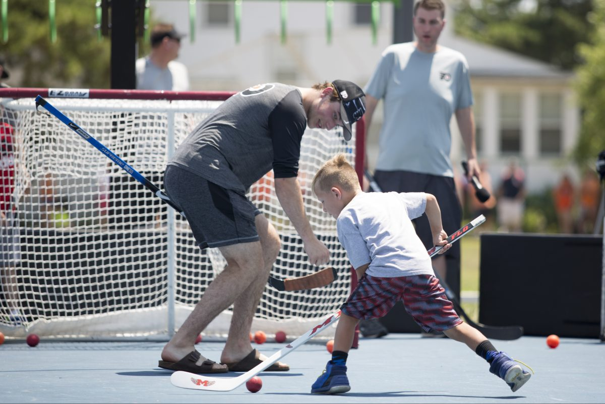 Flyers prospect Nolan Patrick plays goalie as Ryan Jacobs, 6, of West Chester, shoots at the event in Stone Harbor, N.J.
