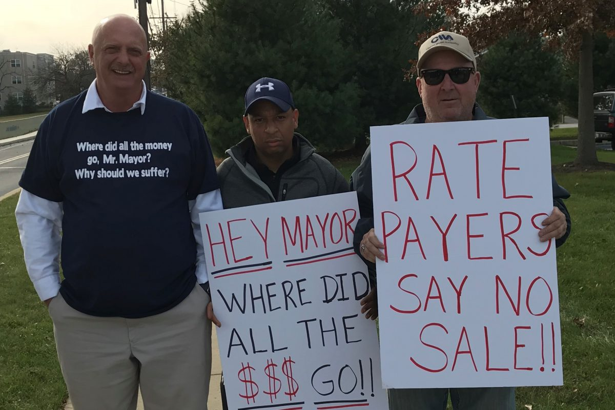 Joe Stafford of Upper Chichester (left), Bill Barber of Chester (center), and Ron Navin Upper Chichester protest outside before a Nov. 2017 meeting of the Chester Water Authority board, which is split among members from Chester City, Delaware County, and Chester County.