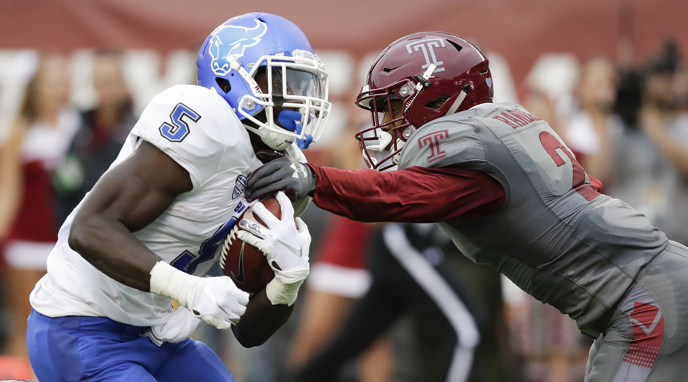 Temple safety Delvon Randall tries to stop Buffalo running back Kevin Marks.