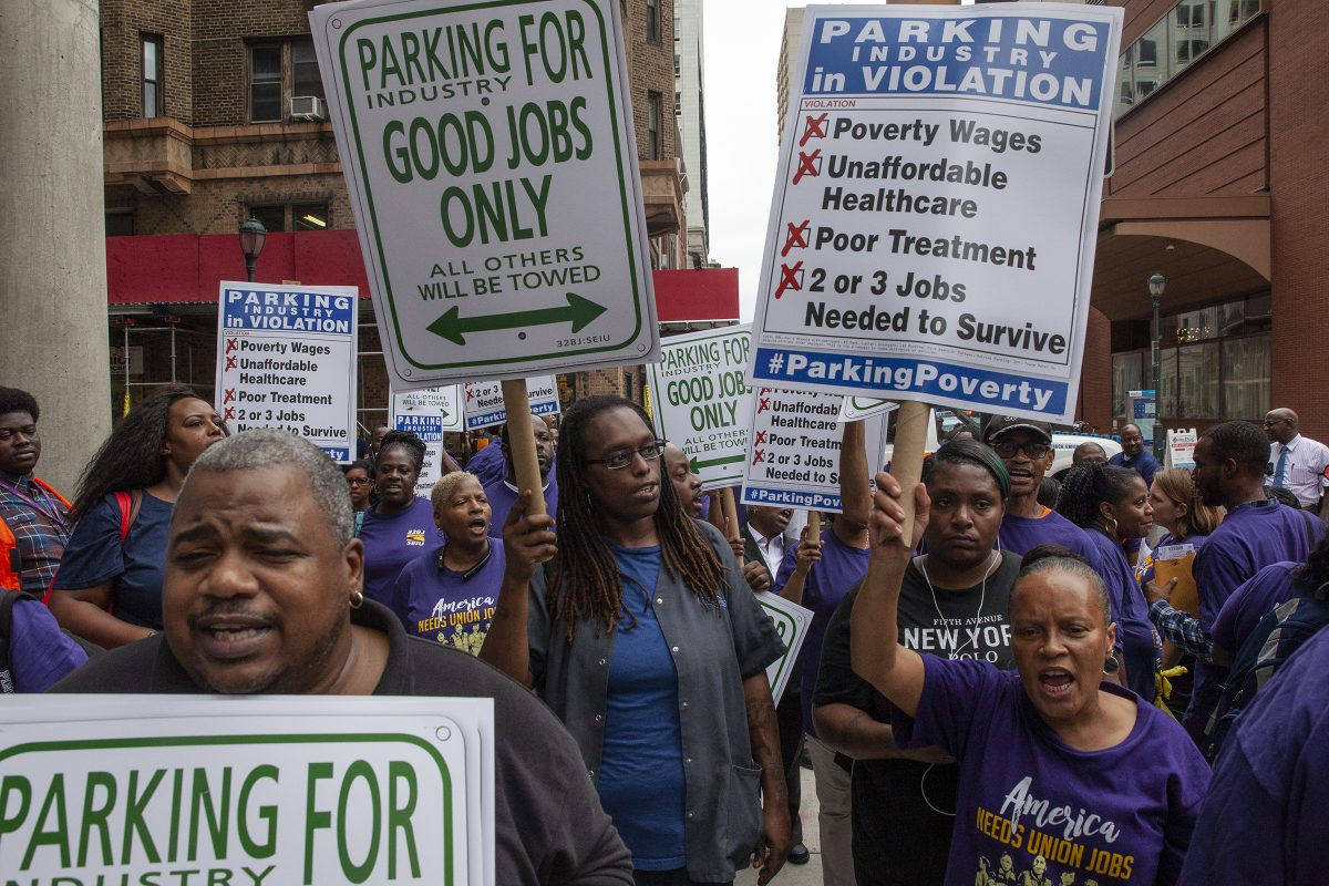 About 50 parking lot attendants and 32BJ SEIU members marched down 16th Street in Center City on Thursday afternoon to raise awareness for the parking lot workers' bid to unionize.