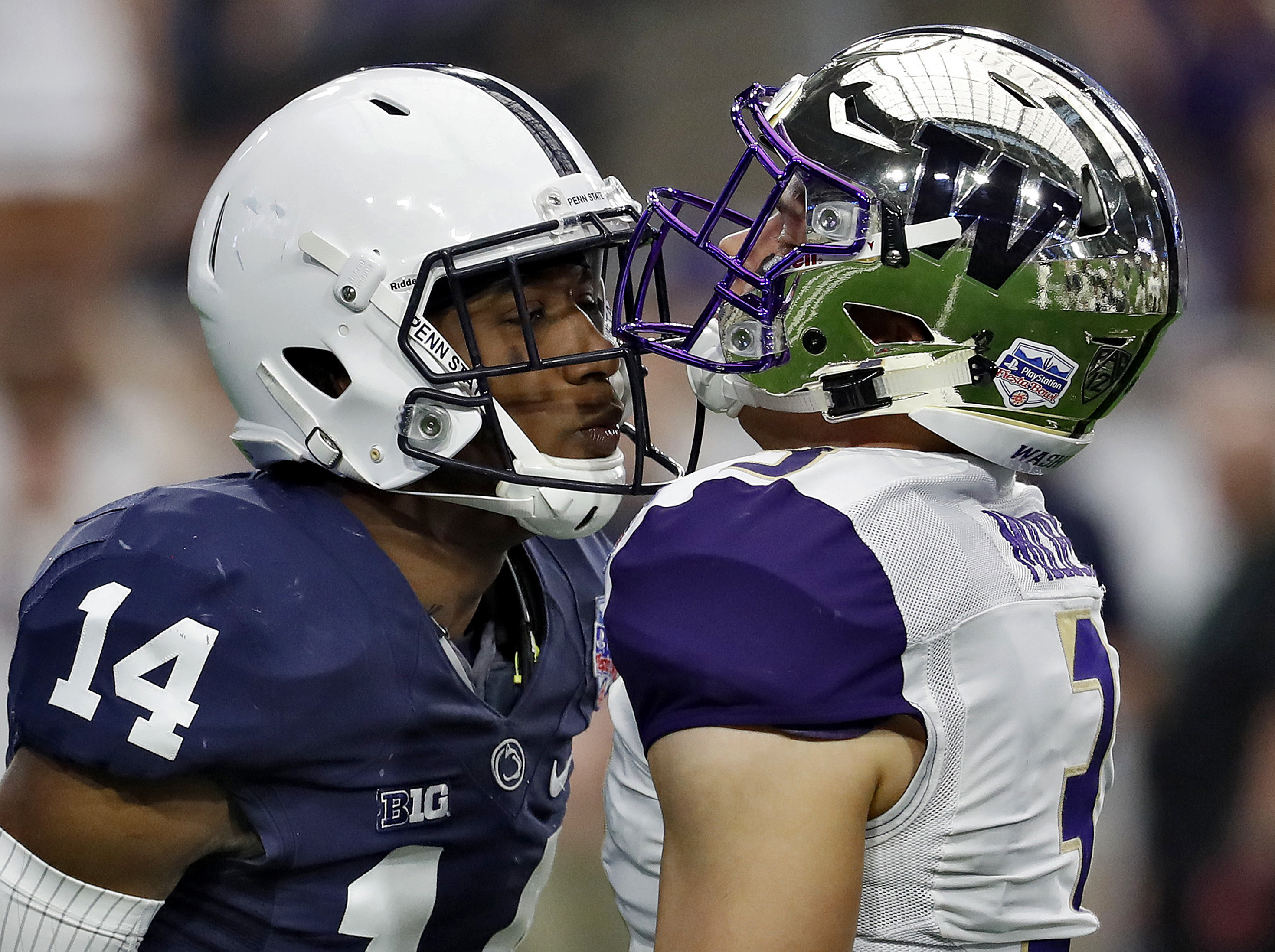 Zech McPhearson, left, exchanging words with Washington quarterback Jake Browning in the Fiesta Bowl last season.
