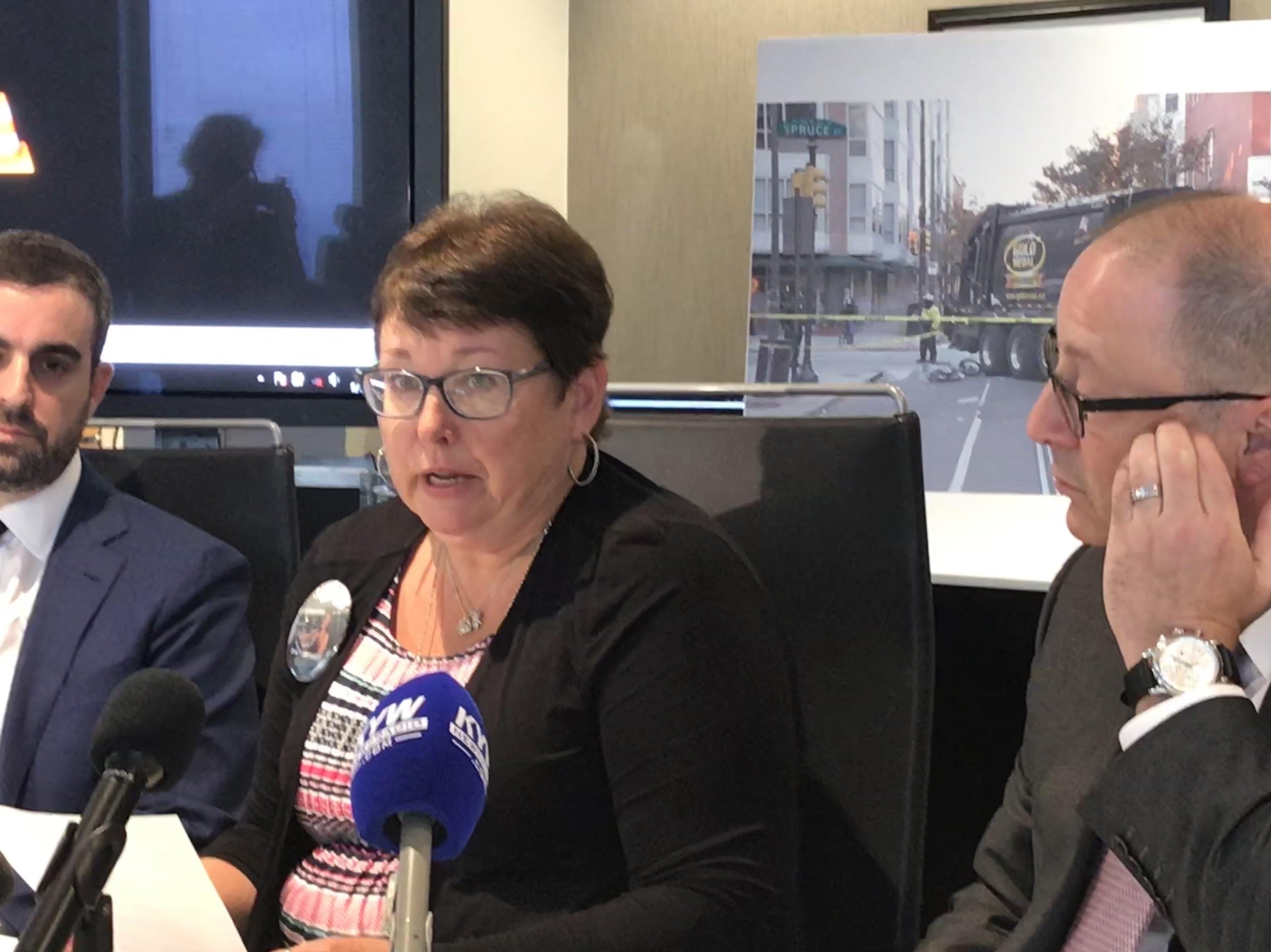 Laura Fredricks, mother of a bicyclist killed last year, Emily Fredricks, speaks to reporters Thursday while flanked by her lawyers Robert Zimmerman (L) and Larry Bendesky (R).