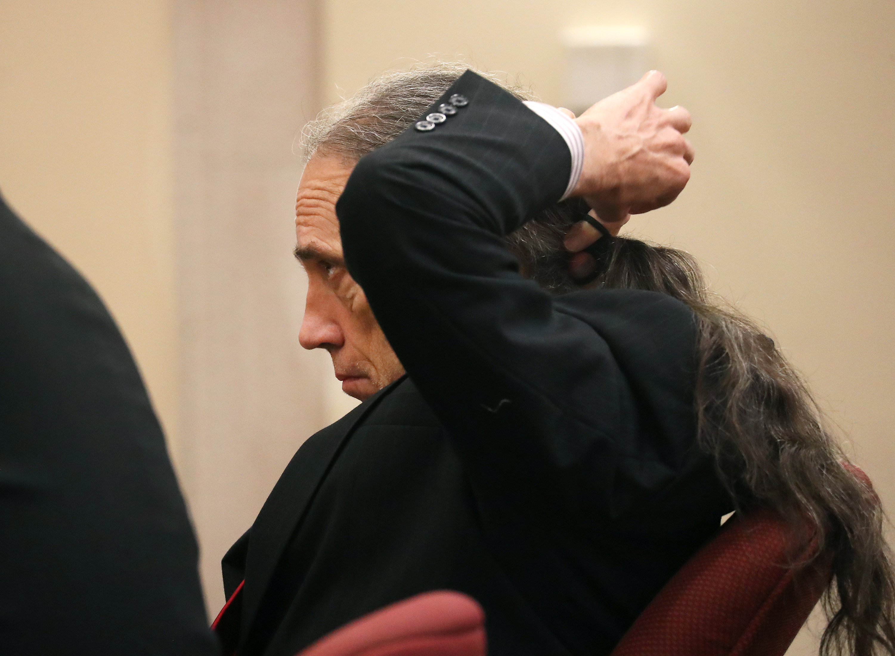 Ferdinand Augello puts his hair in a ponytail as his trial begins at the Atlantic County Justice Facility in Mays Landing, Monday, Sept. 17, 2018. Augello is accused of setting up the killing of April Kauffman to protect an Oxycontin ring Augello and Dr. James Kauffman allegedly set up. (POOL PHOTO | Lori M. Nichols | NJ Advance Media for NJ.com)