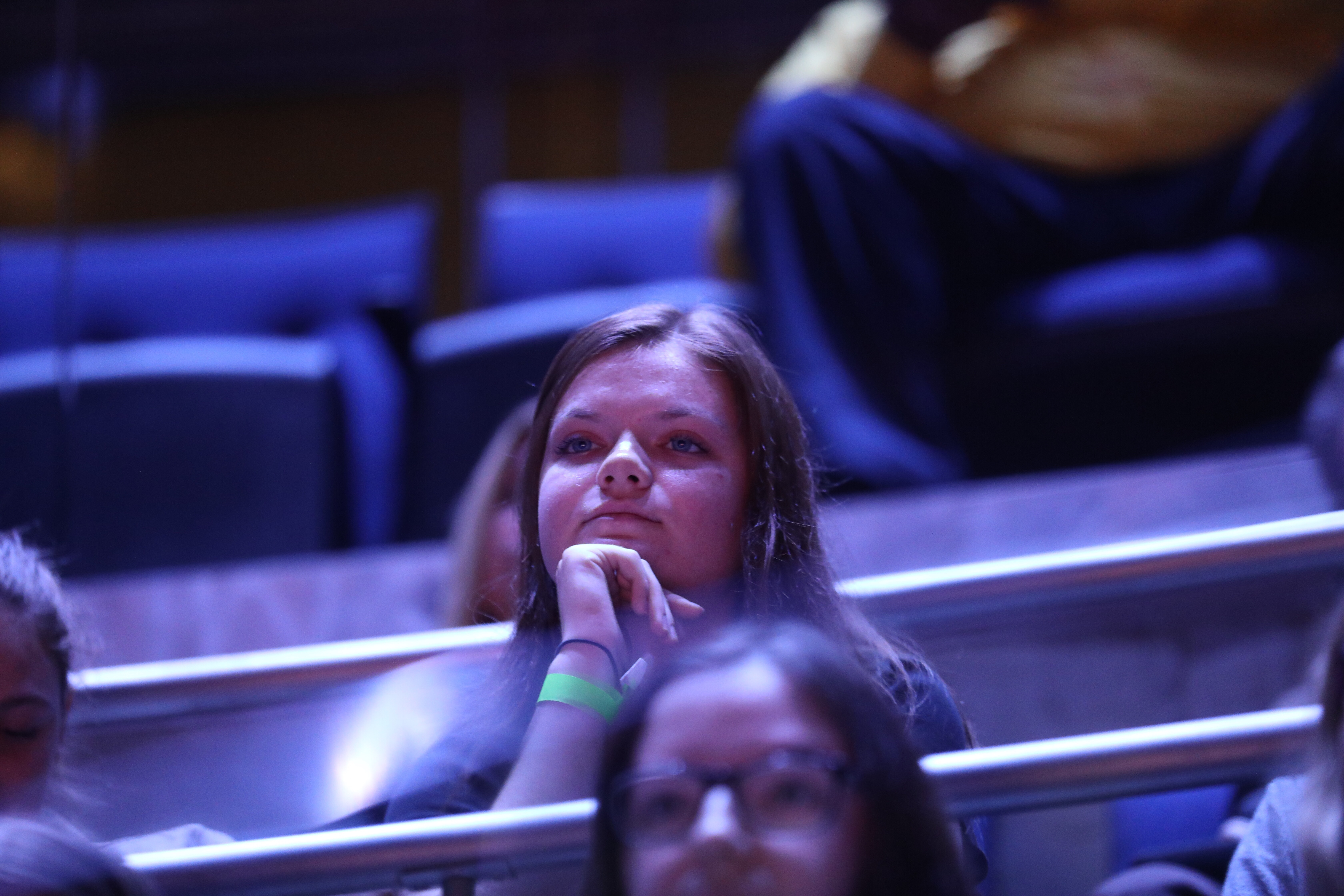 Kaileigh Murphy, 21, a senior at the College of New Jersey, listens to her question answered from U.S. Secretary of Education Betsy DeVos.