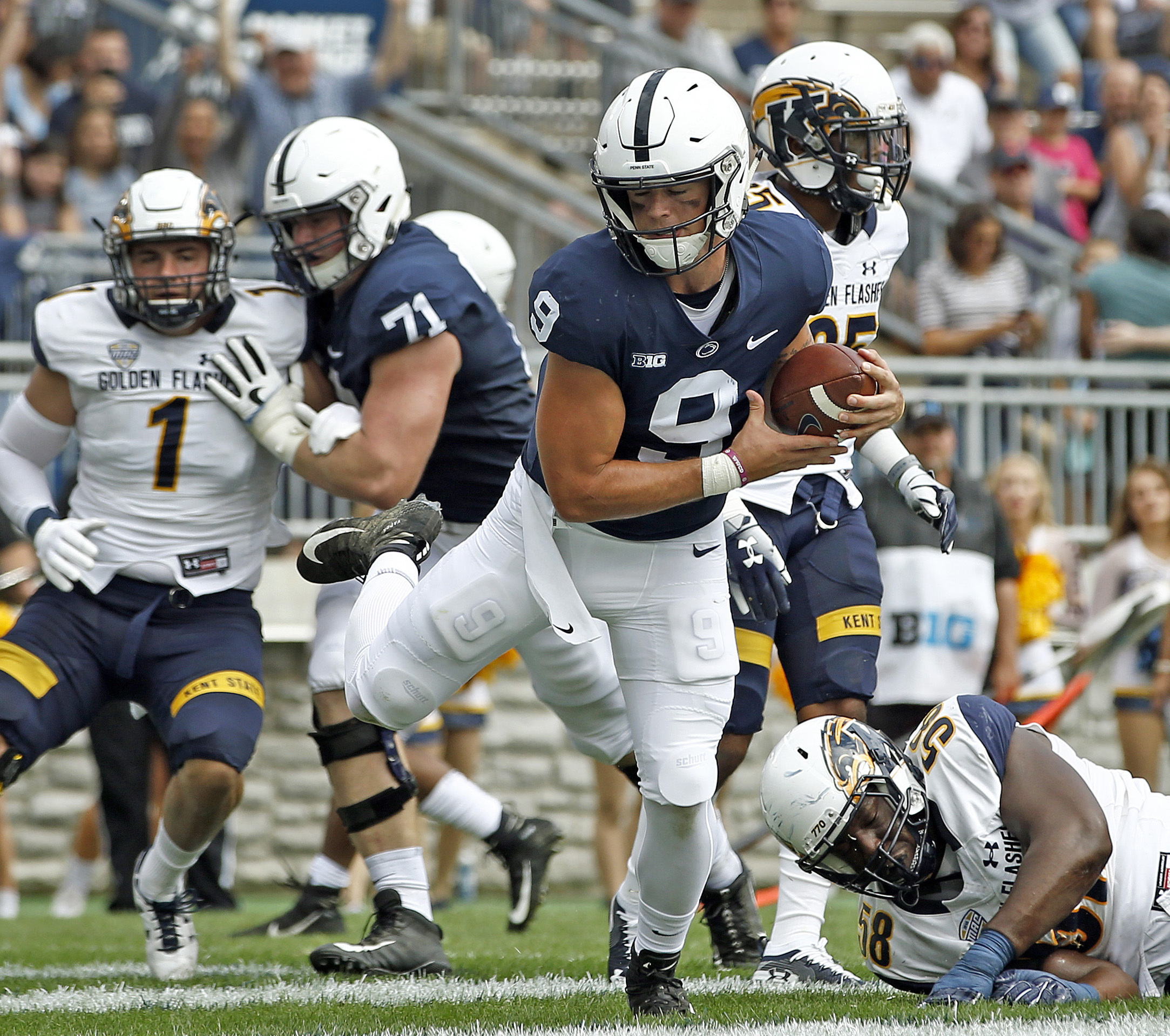 Trace McSorley runs in for a touchdown on Saturday.